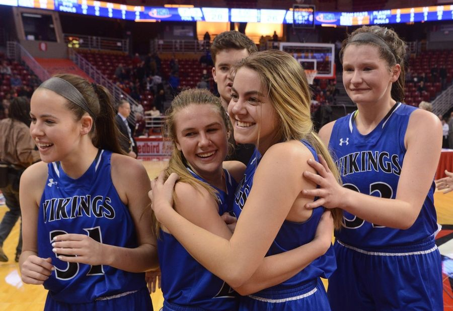 Geneva's Stephanie Hart, second from right, celebrates with her teammates after hitting the game-winning shot during the girls basketball Class 4A title game against Montini at Redbird Arena in Normal Saturday.