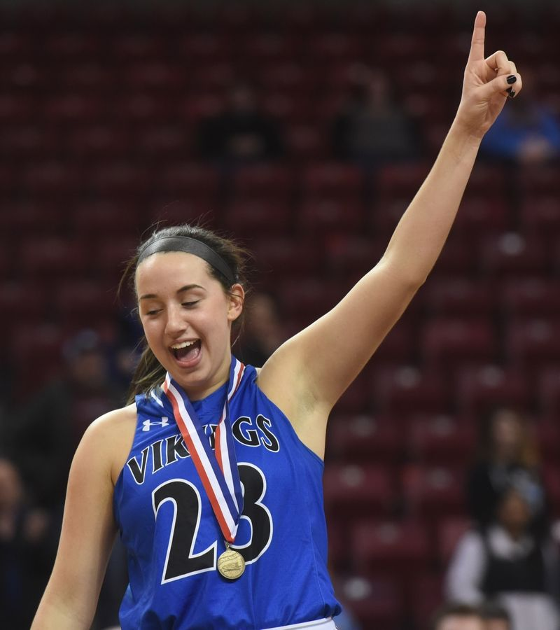 Joe Lewnard/jlewnard@dailyherald.comGeneva's Margaret Whitley celebrates after receiving her medal after the Vikings defeated Montini 28-26 during the girls basketball Class 4A title game at Redbird Arena in Normal Saturday.