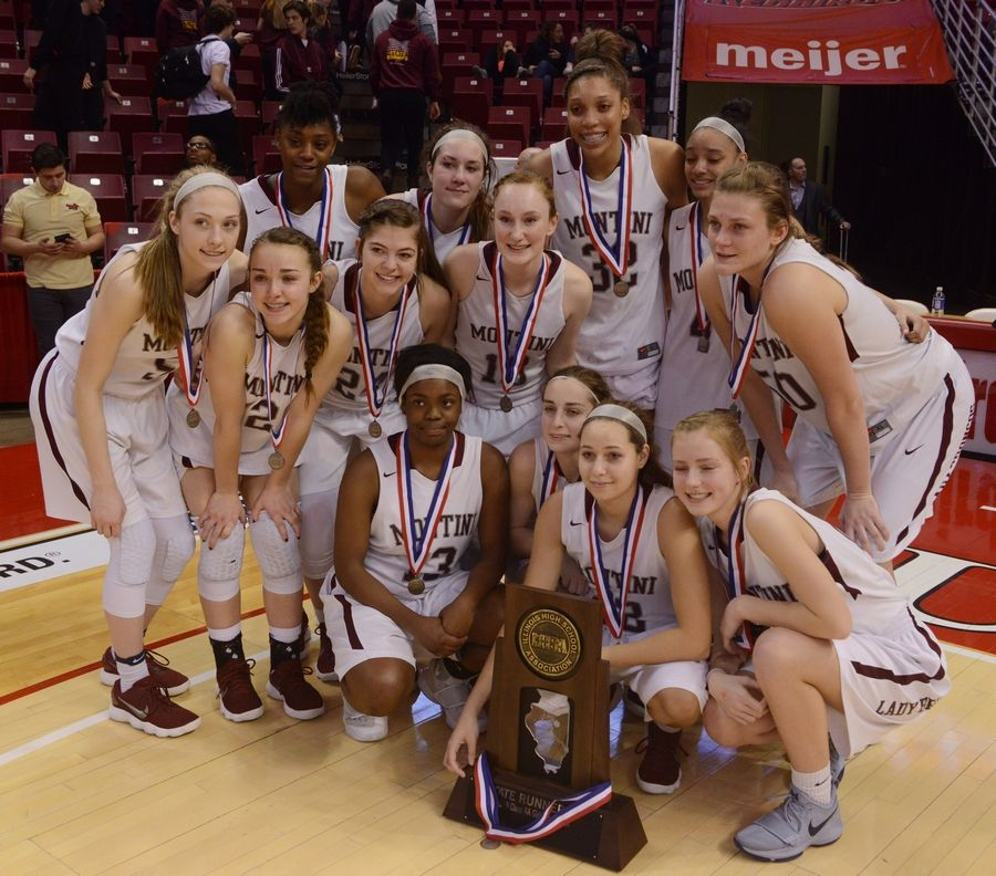 Montini players pose with their second-place trophy following the girls basketball Class 4A title game at Redbird Arena in Normal Saturday.