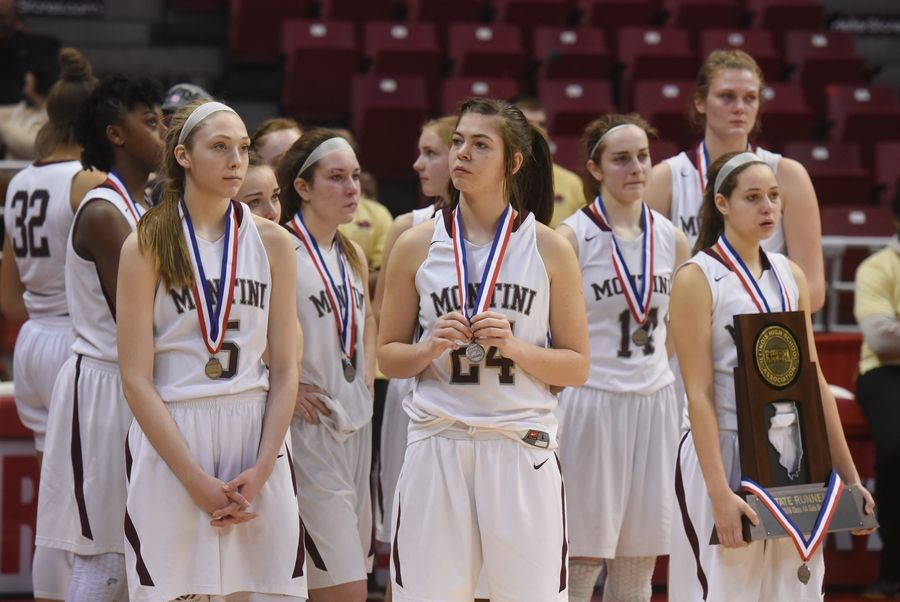 Montini players watch their Geneva counterparts receive their state championship medals after losing to the Vikings 28-26 during the girls basketball Class 4A title game at Redbird Arena in Normal Saturday.