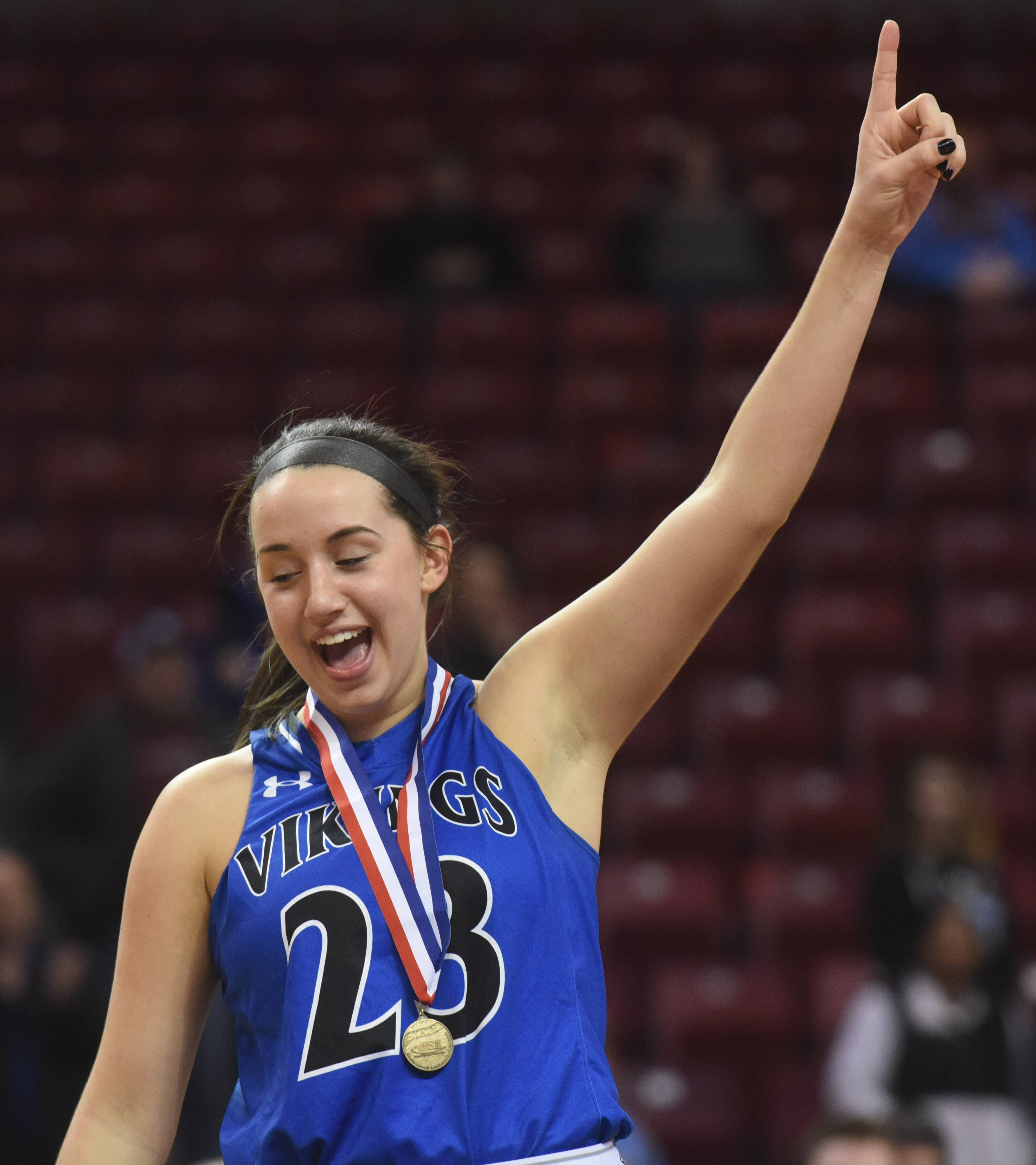 Geneva's Margaret Whitely celebrates after receiving her medal after the Vikings defeated Montini 28-26 during the girls basketball Class 4A title game at Redbird Arena in Normal Saturday.