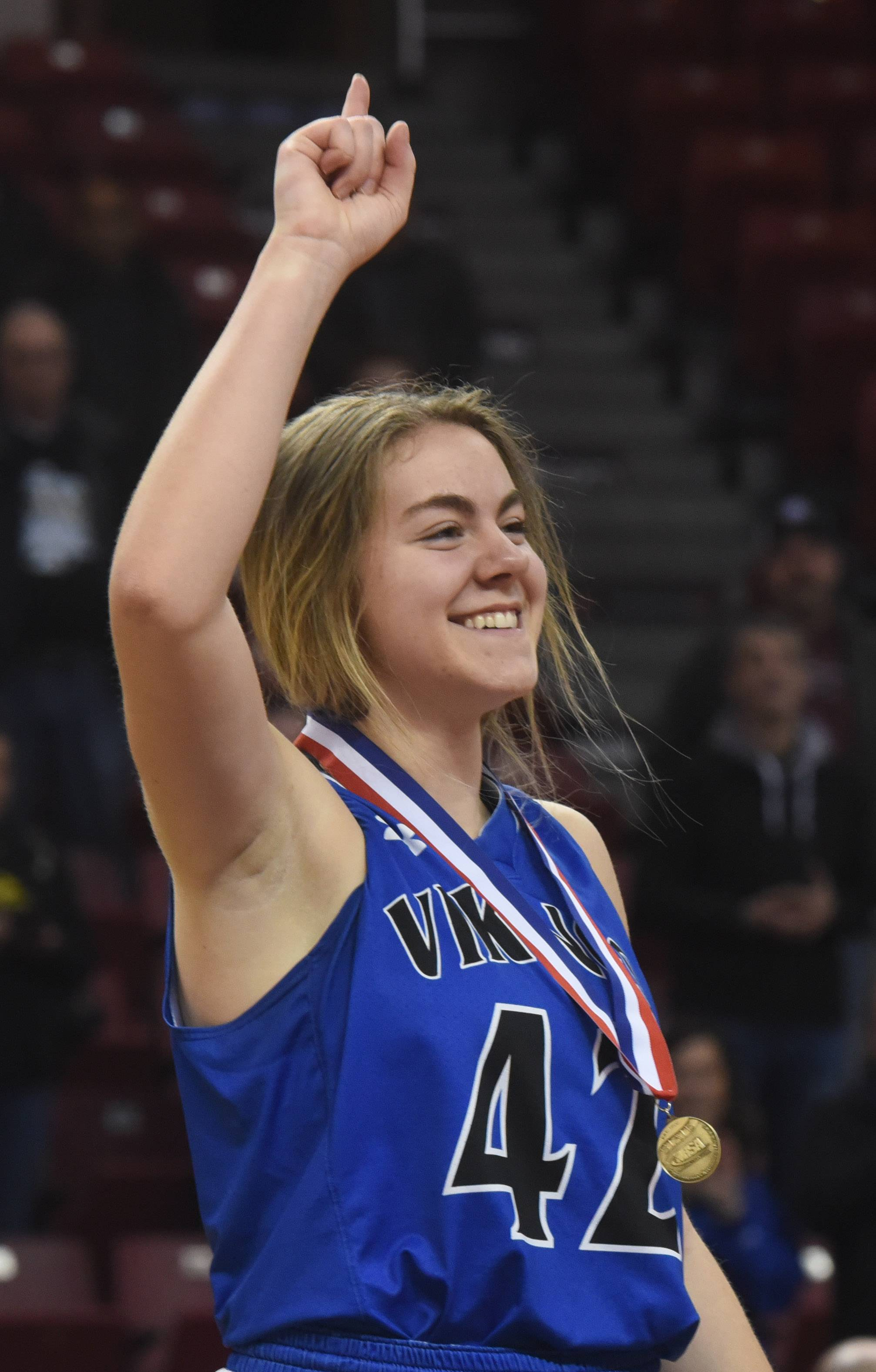 Geneva's Stephanie Hart receives her state championship medal following the girls basketball Class 4A title game against Montini at Redbird Arena in Normal Saturday.