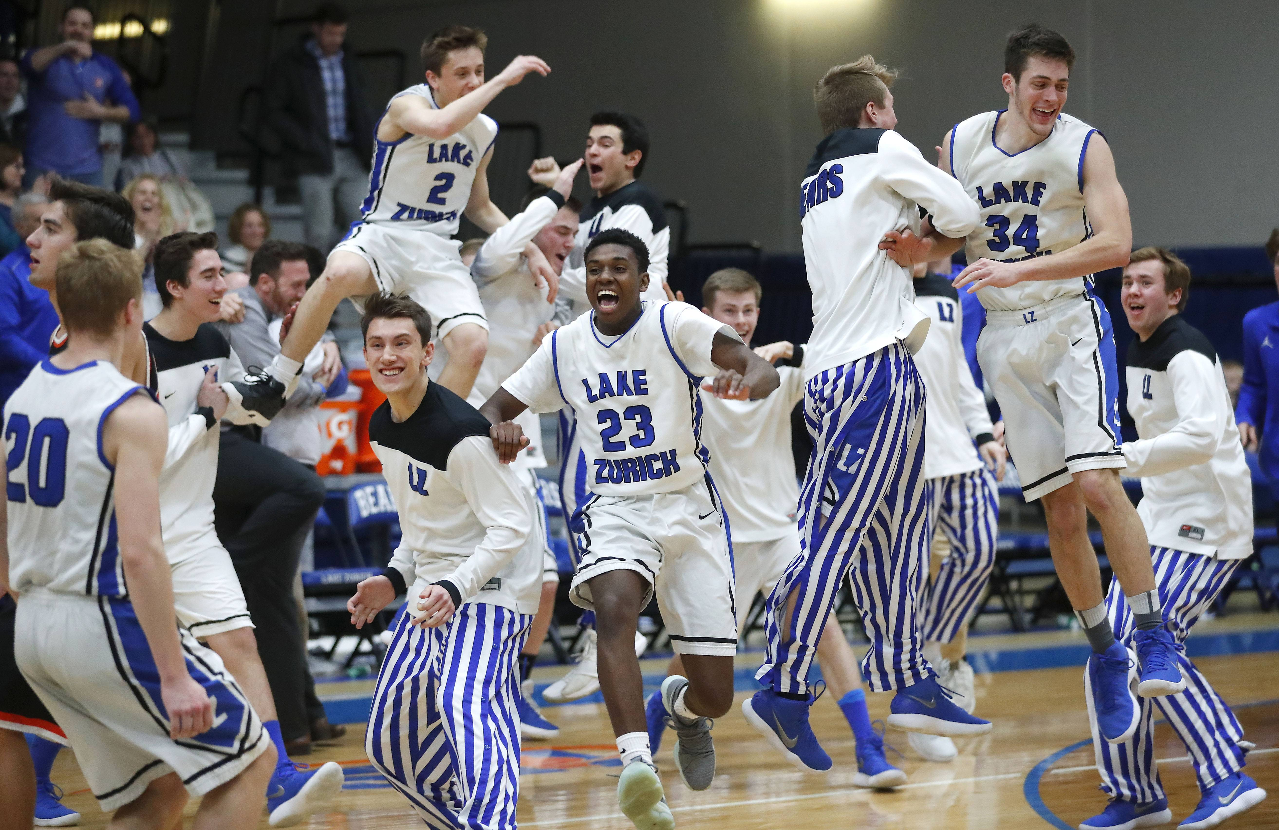 Lake Zurich players go crazy after beating Libertyville 54-50 in the Class 4A sectional semifinal at Lake Zurich High School on Tuesday.