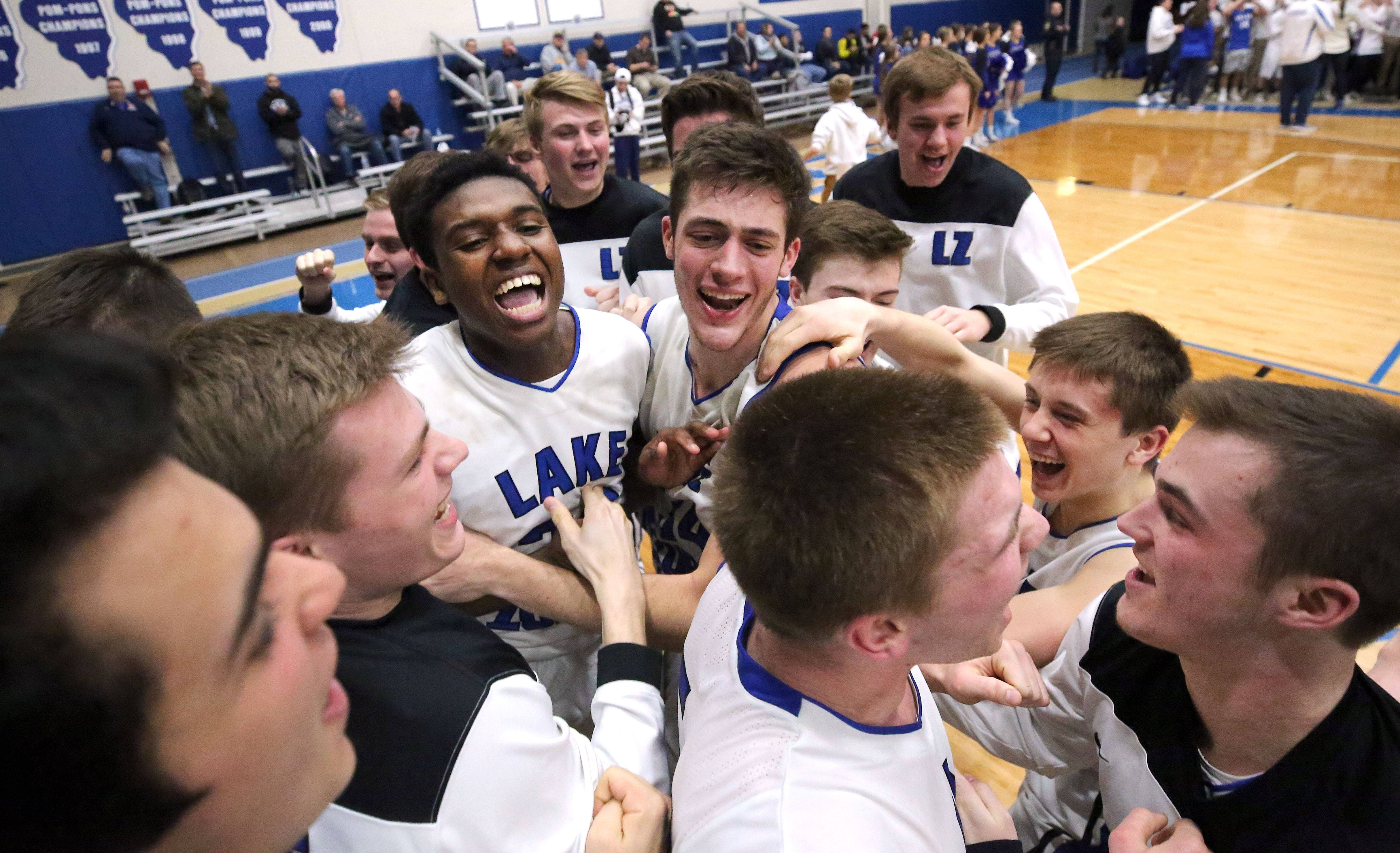 Lake Zurich players celebrate after beating Libertyville 54-50 in the Class 4A sectional semifinal at Lake Zurich High School on Tuesday.