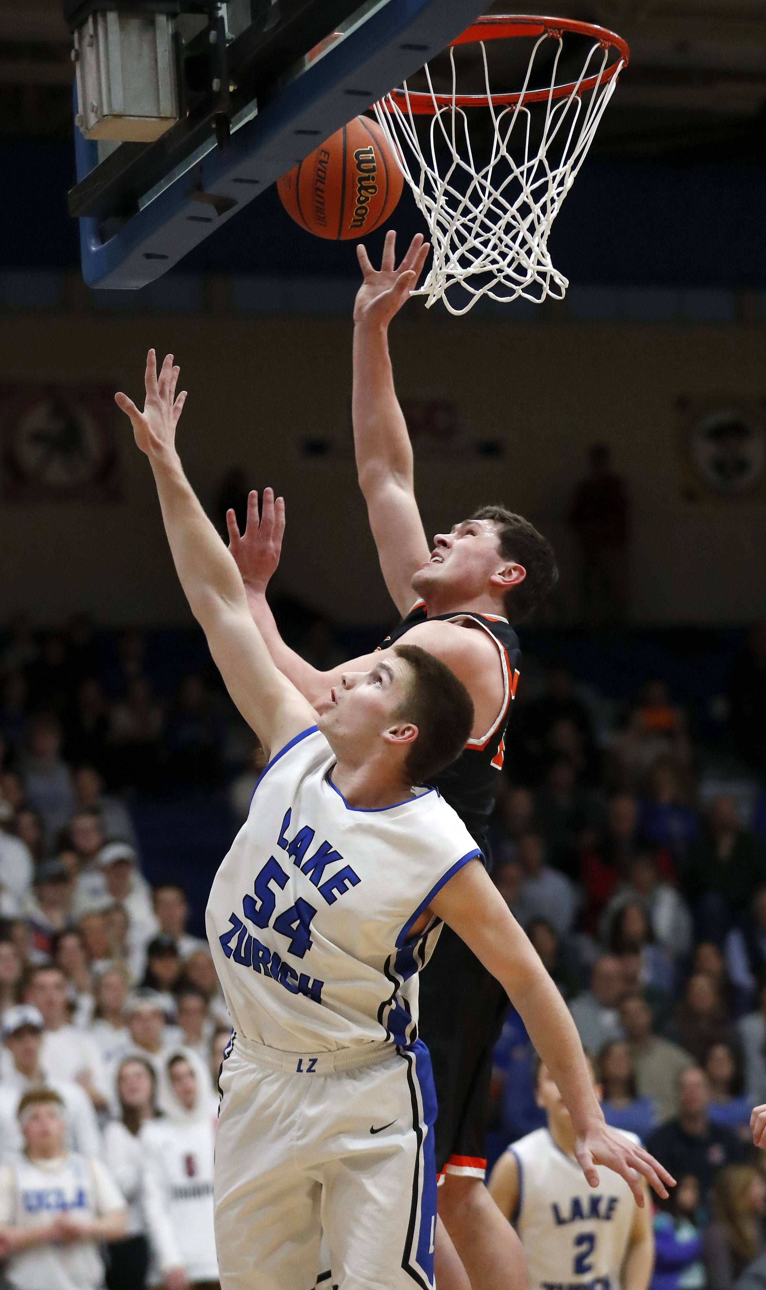 Libertyville's Brendan Cook shoots over Lake Zurich's Peter DiCerbo (54) during the Class 4A sectional semifinal at Lake Zurich High School on Tuesday.