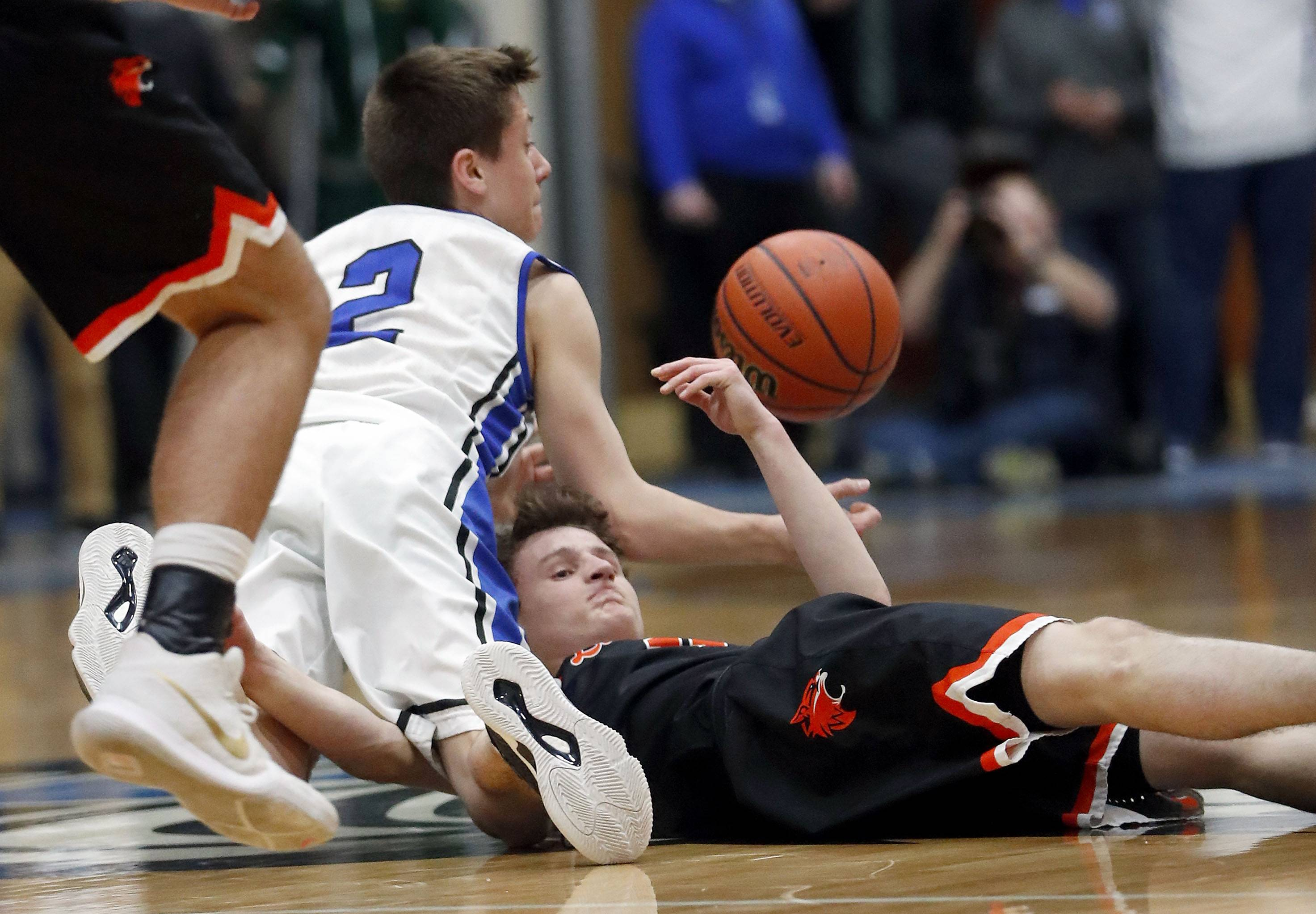 Lake Zurich's JR Cison (2) and Libertyville's Josh Steinhaus battle for a loose ball during the Class 4A sectional semifinal at Lake Zurich High School on Tuesday.