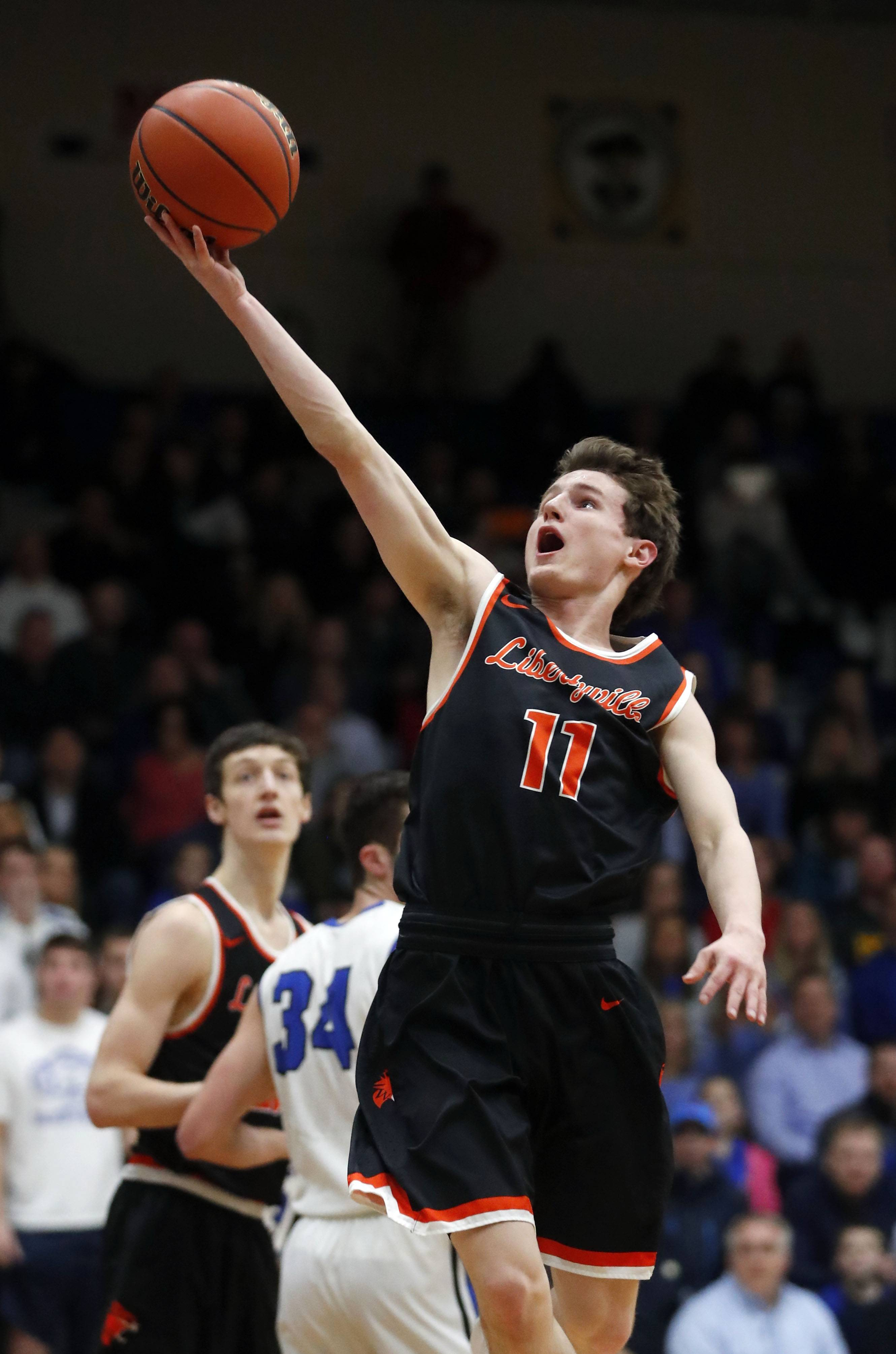 Libertyville's Josh Steinhaus drives for a layup during the Class 4A sectional semifinal at Lake Zurich High School on Tuesday.