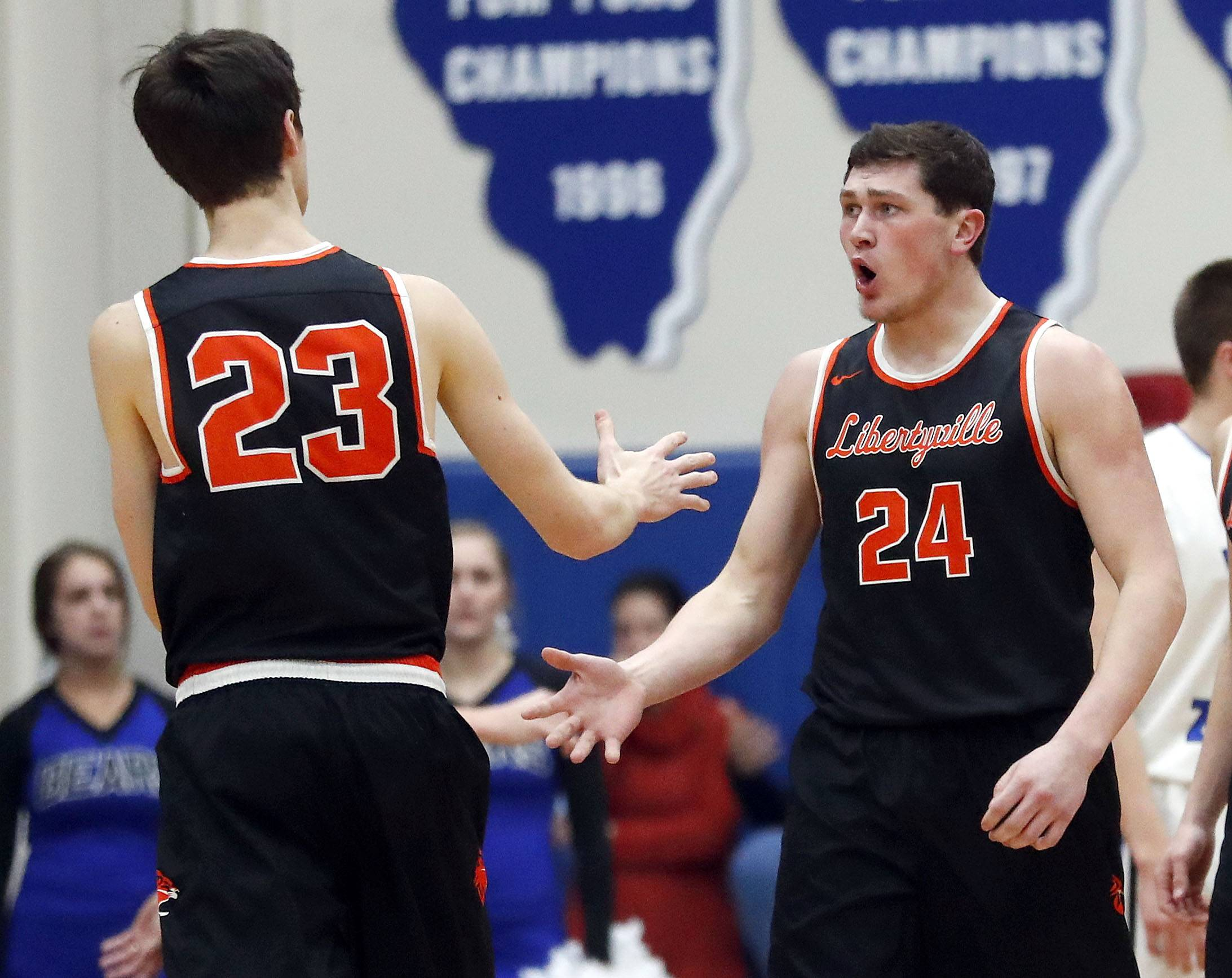 Libertyville's Brendan Cook celebrates with Libertyville's Drew Peterson (23) during the Class 4A sectional semifinal at Lake Zurich High School on Tuesday.