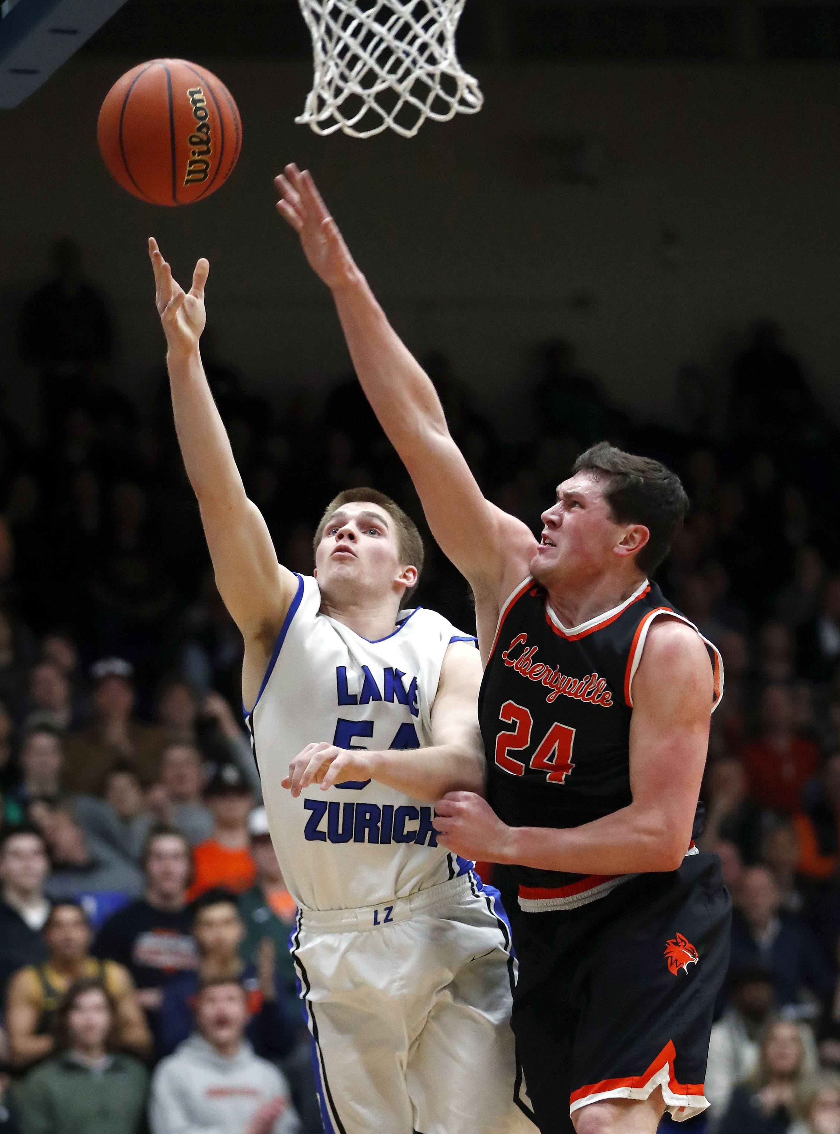 Lake Zurich's Peter DiCerbo, left, drives on Libertyville's Brendan Cook during the Class 4A sectional semifinal at Lake Zurich High School on Tuesday.