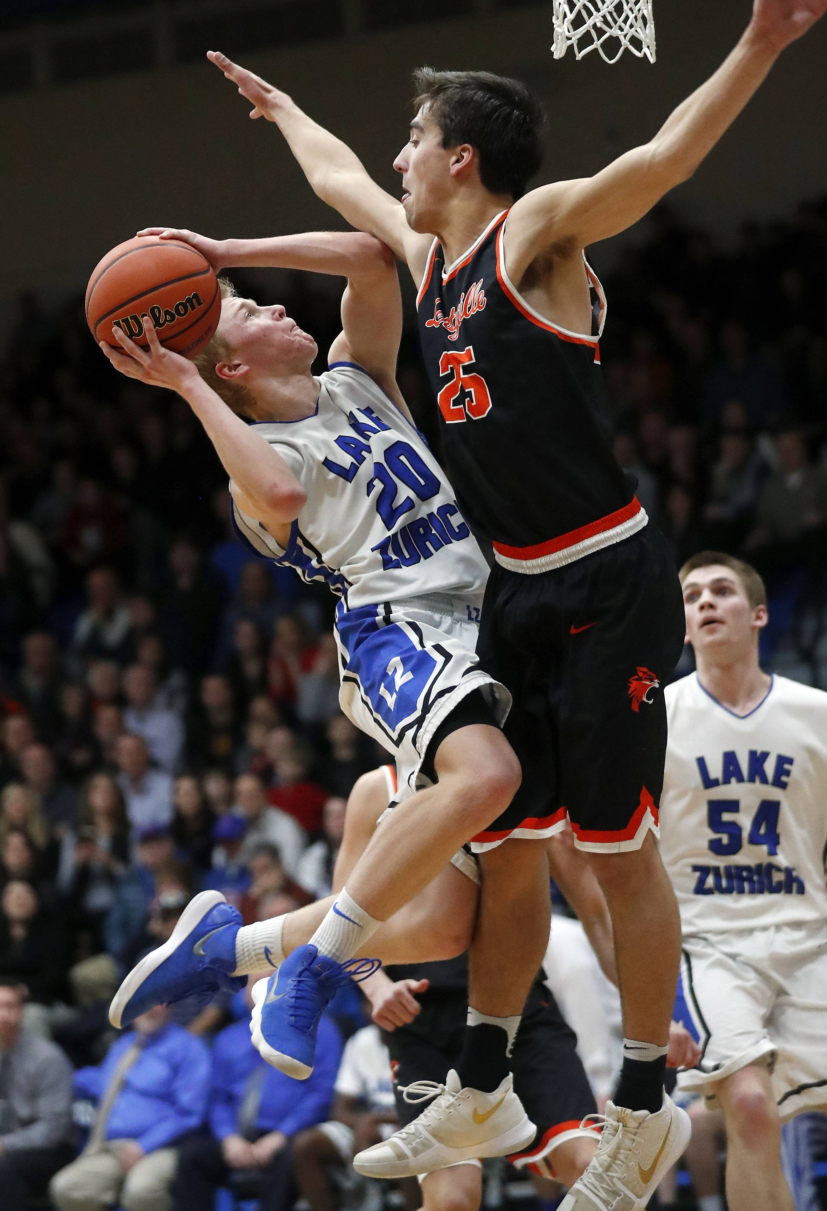 Lake Zurich's Joe Heffernan, left, drives on Libertyville's Chase Eyre during the Class 4A sectional semifinal at Lake Zurich High School on Tuesday.
