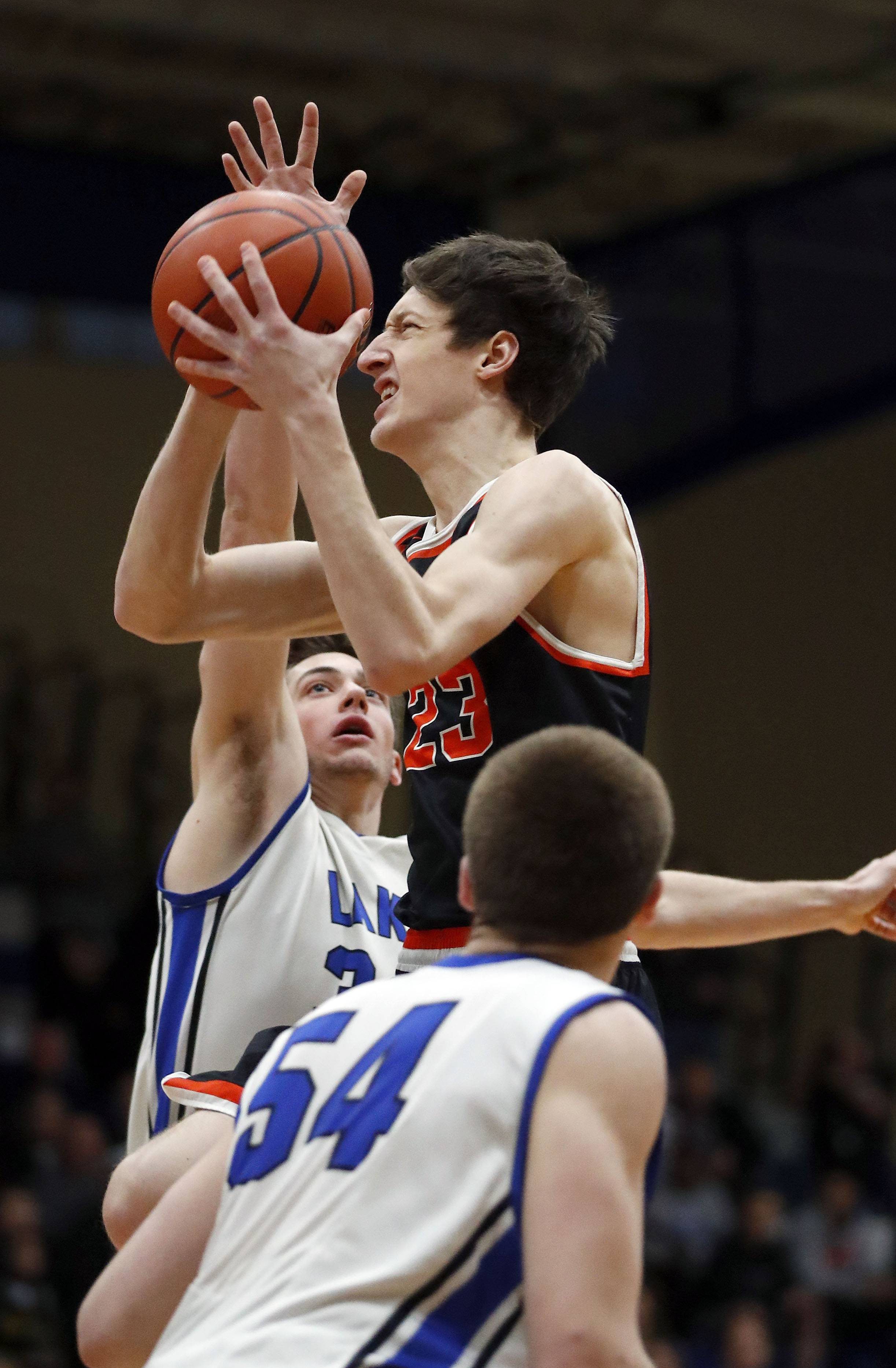Libertyville's Drew Peterson, right, drives on Lake Zurich's Ryan Kutsor during the Class 4A sectional semifinal at Lake Zurich High School on Tuesday.