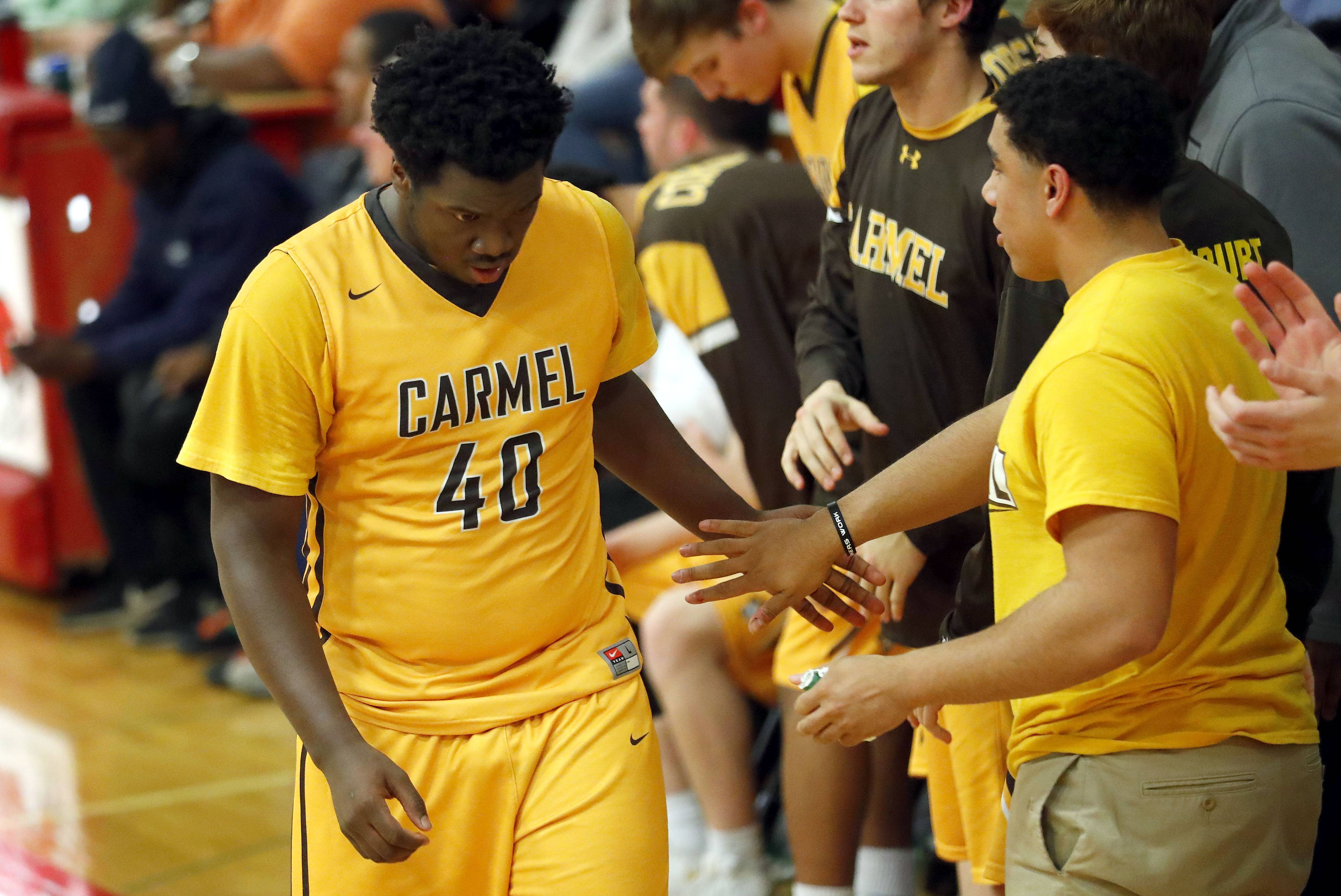 Carmel's Jalen Snell fouls out during Class 3A sectional semifinal play Wednesday at North Chicago.