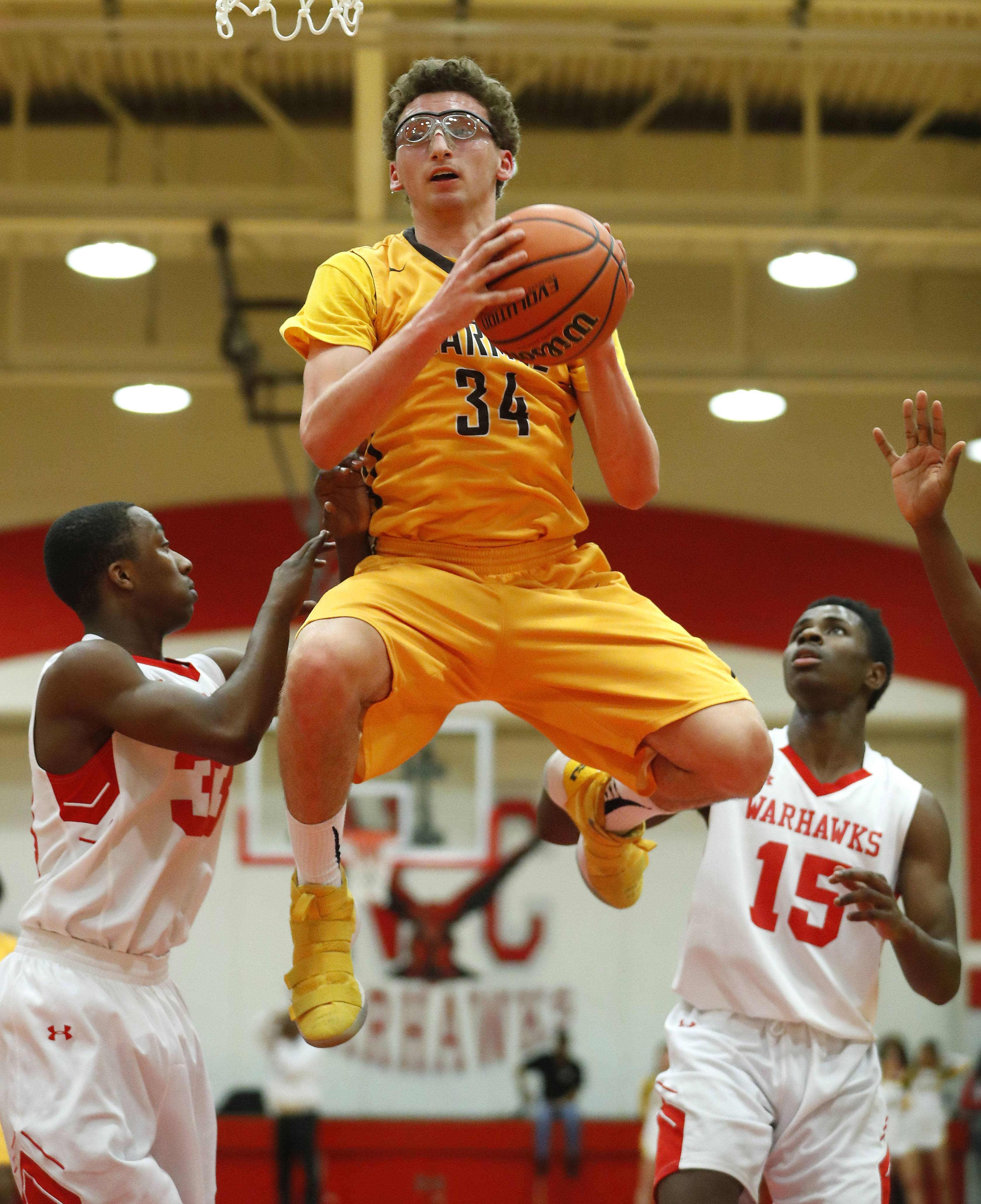 Carmel's Johnny Roeser grabs a rebound during Class 3A sectional semifinal play Wednesday at North Chicago.