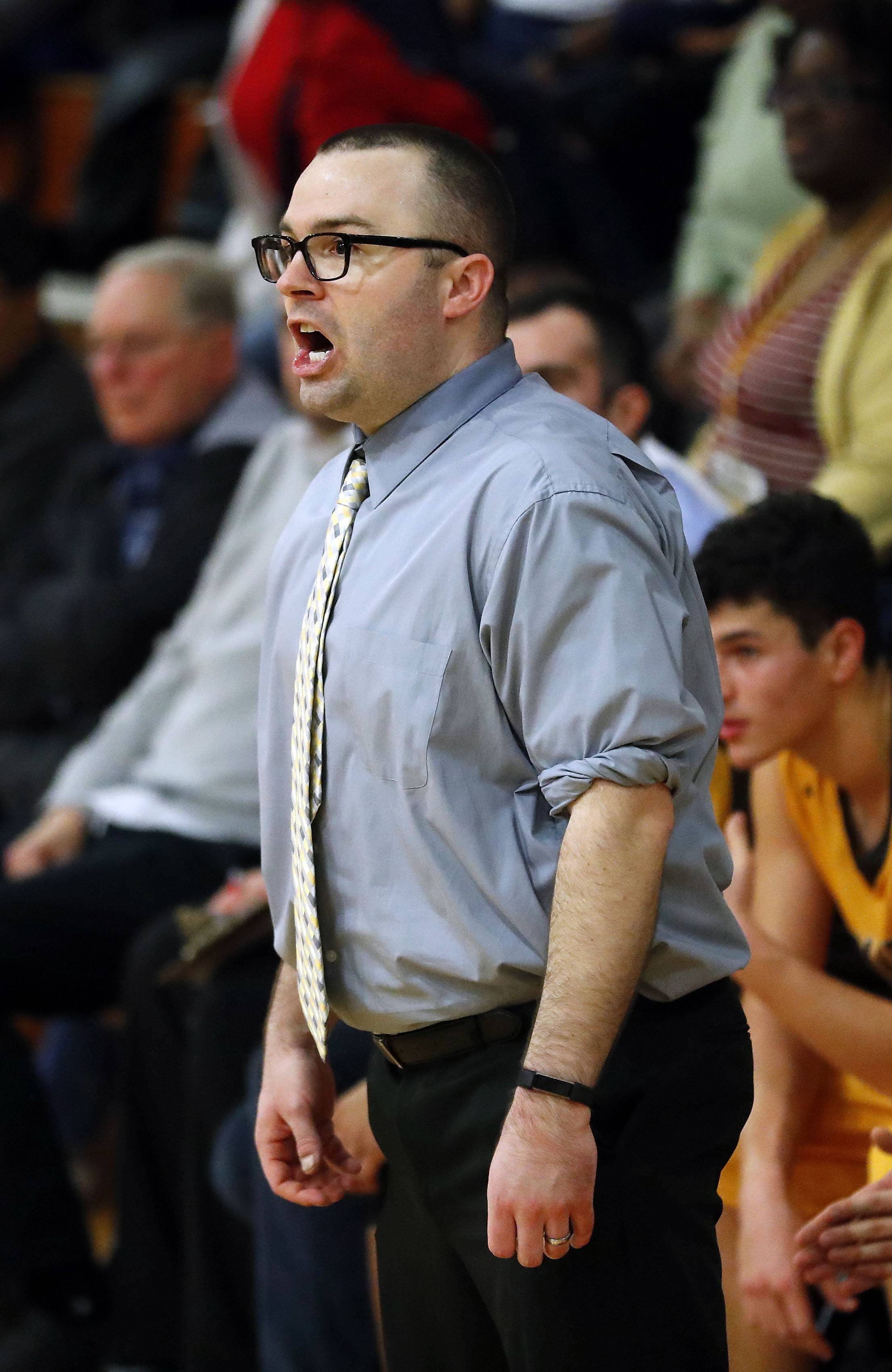 Carmel coach Zack Ryan calls out a play during Class 3A sectional semifinal play Wednesday at North Chicago.