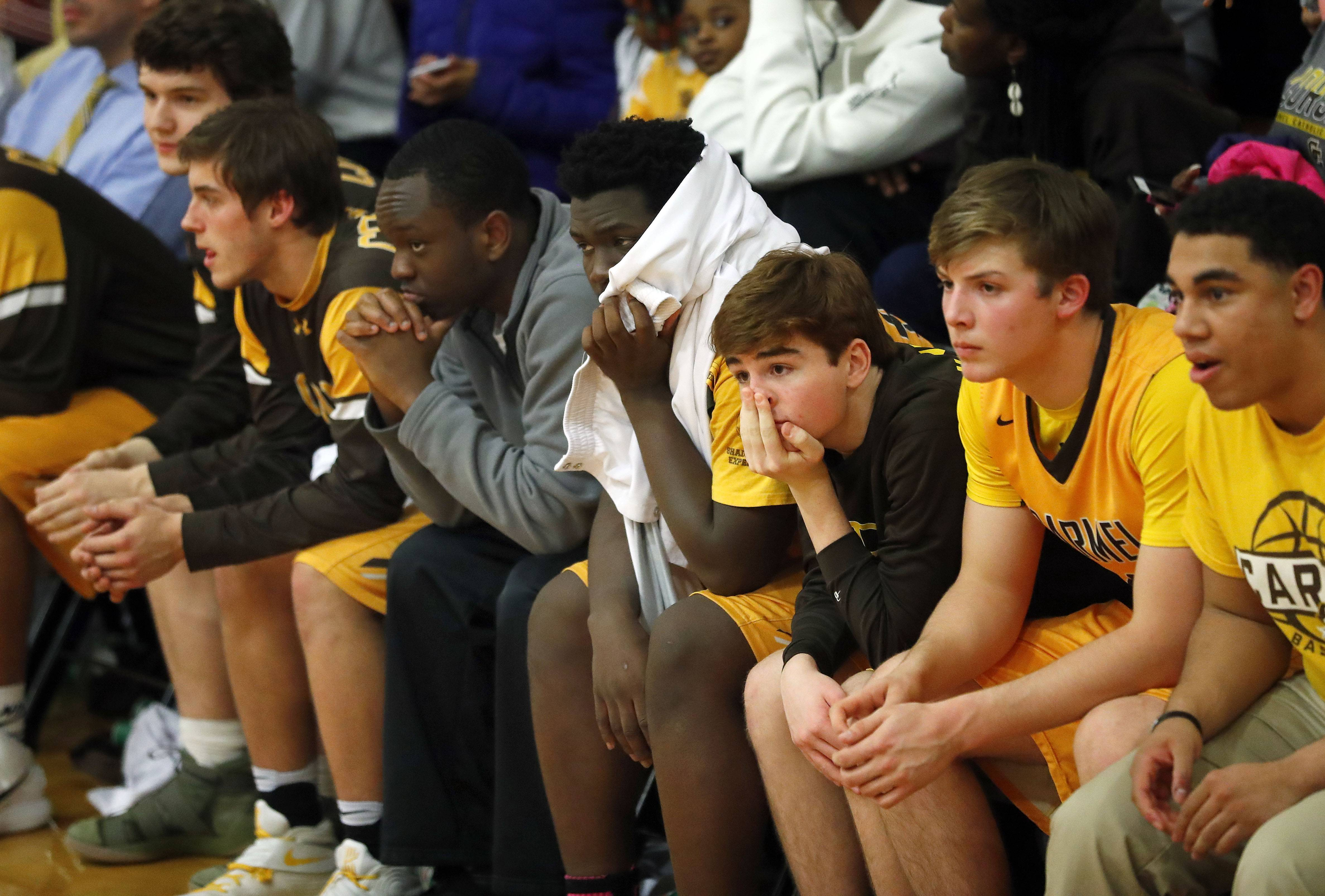 The Carmel bench looks on during Class 3A sectional semifinal play Wednesday at North Chicago.