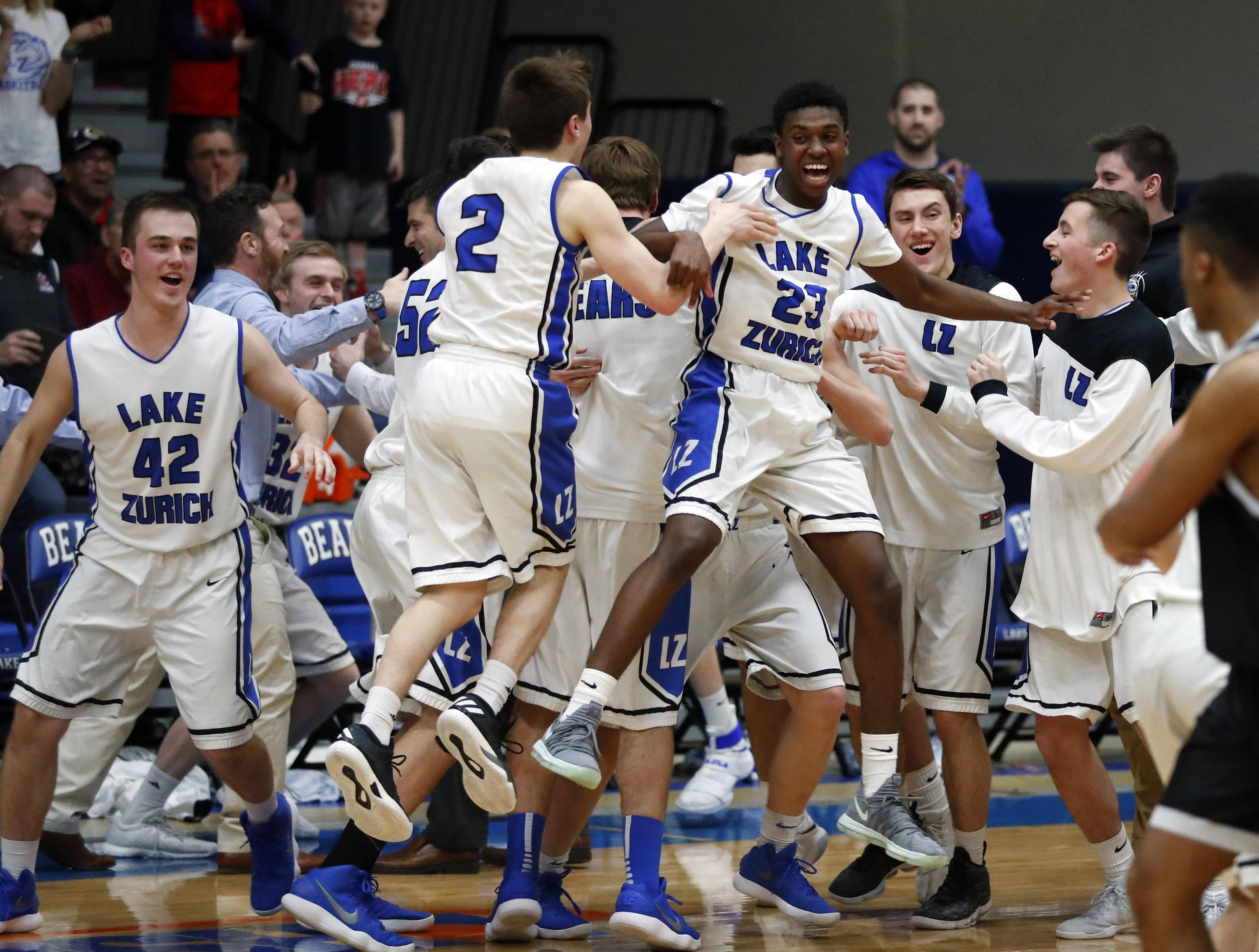 Lake Zurich players react during their 69-60 win over Barrington in the Class 4A sectional final at Lake Zurich on Friday.