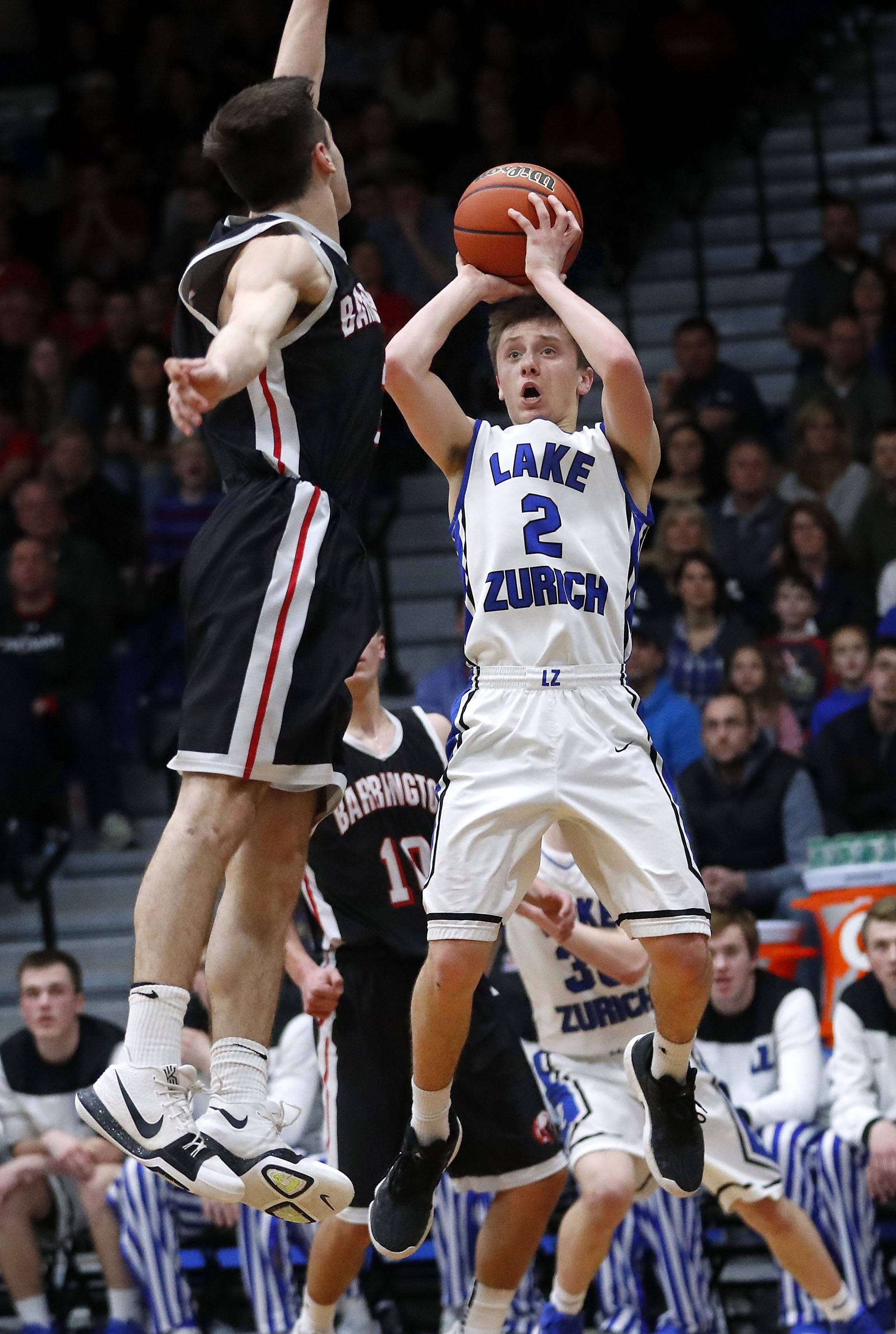 Lake Zurich's JR Cison shoots over Barrington's Mark Johnson during the Class 4A sectional final at Lake Zurich on Friday.