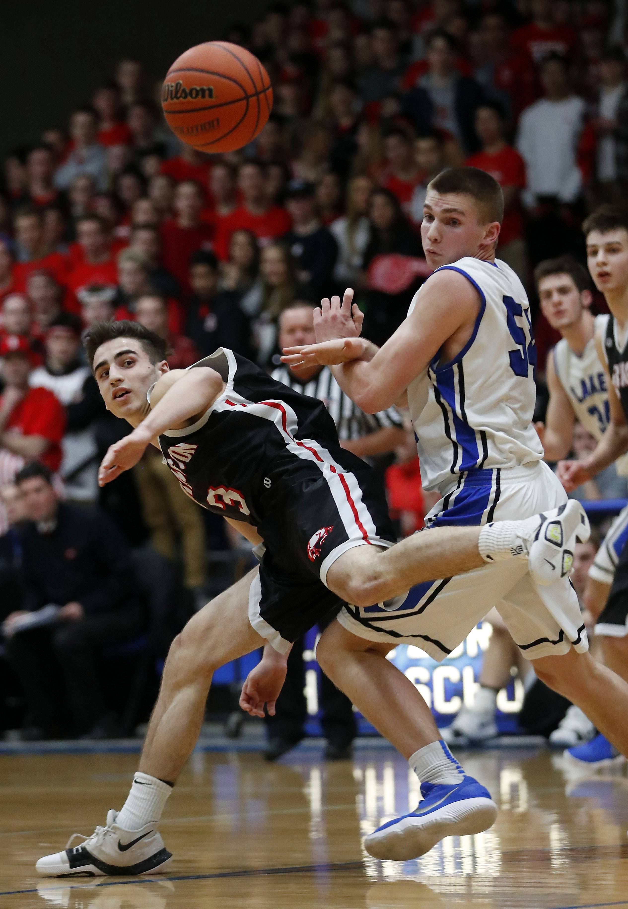 Barrington's Mark Johnson, left, and Lake Zurich's Peter DiCerbo battle for a rebound during the Class 4A sectional final at Lake Zurich on Friday.