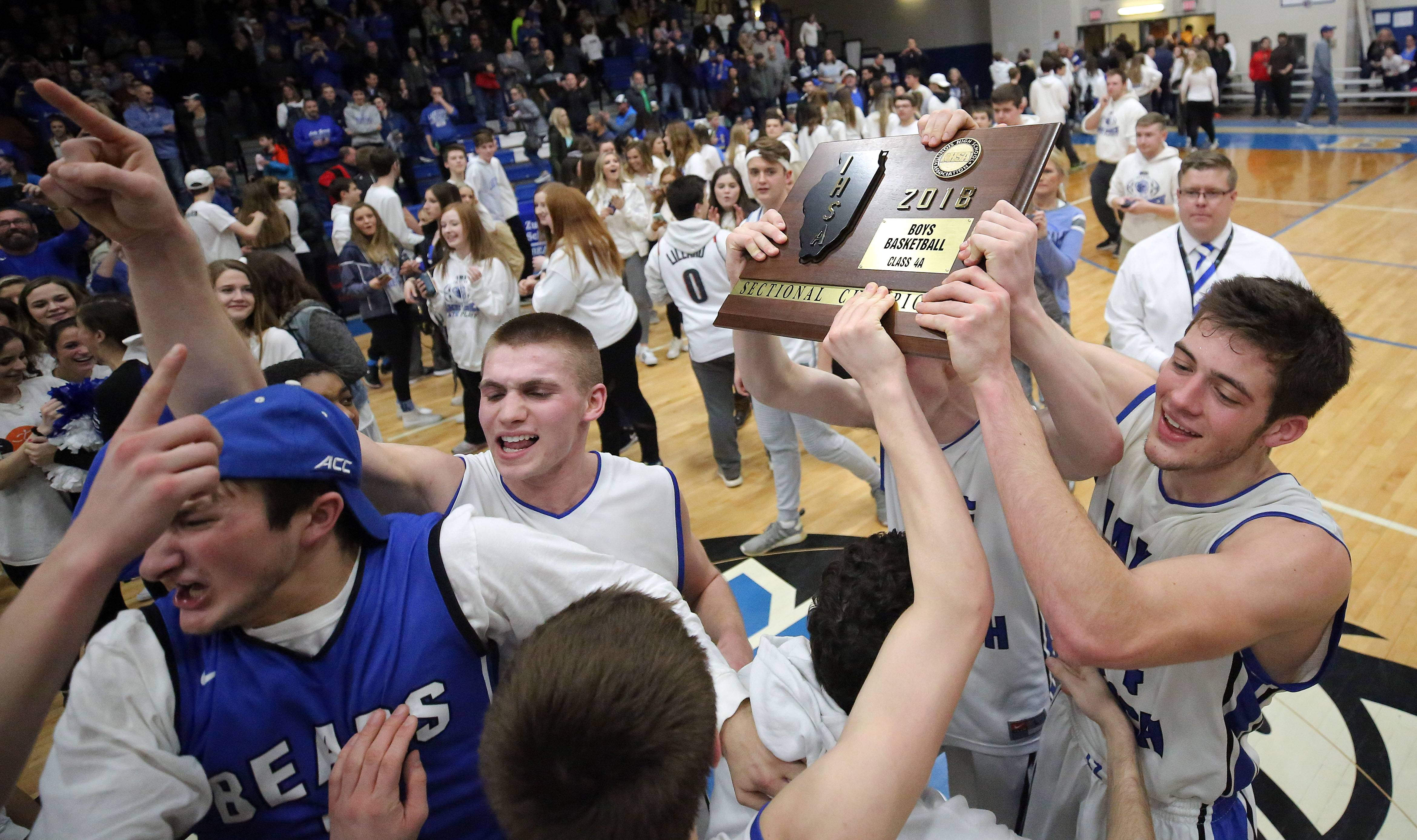 Players carry the sectional trophy after their 69-60 win over Barrington in the Class 4A sectional final at Lake Zurich on Friday.