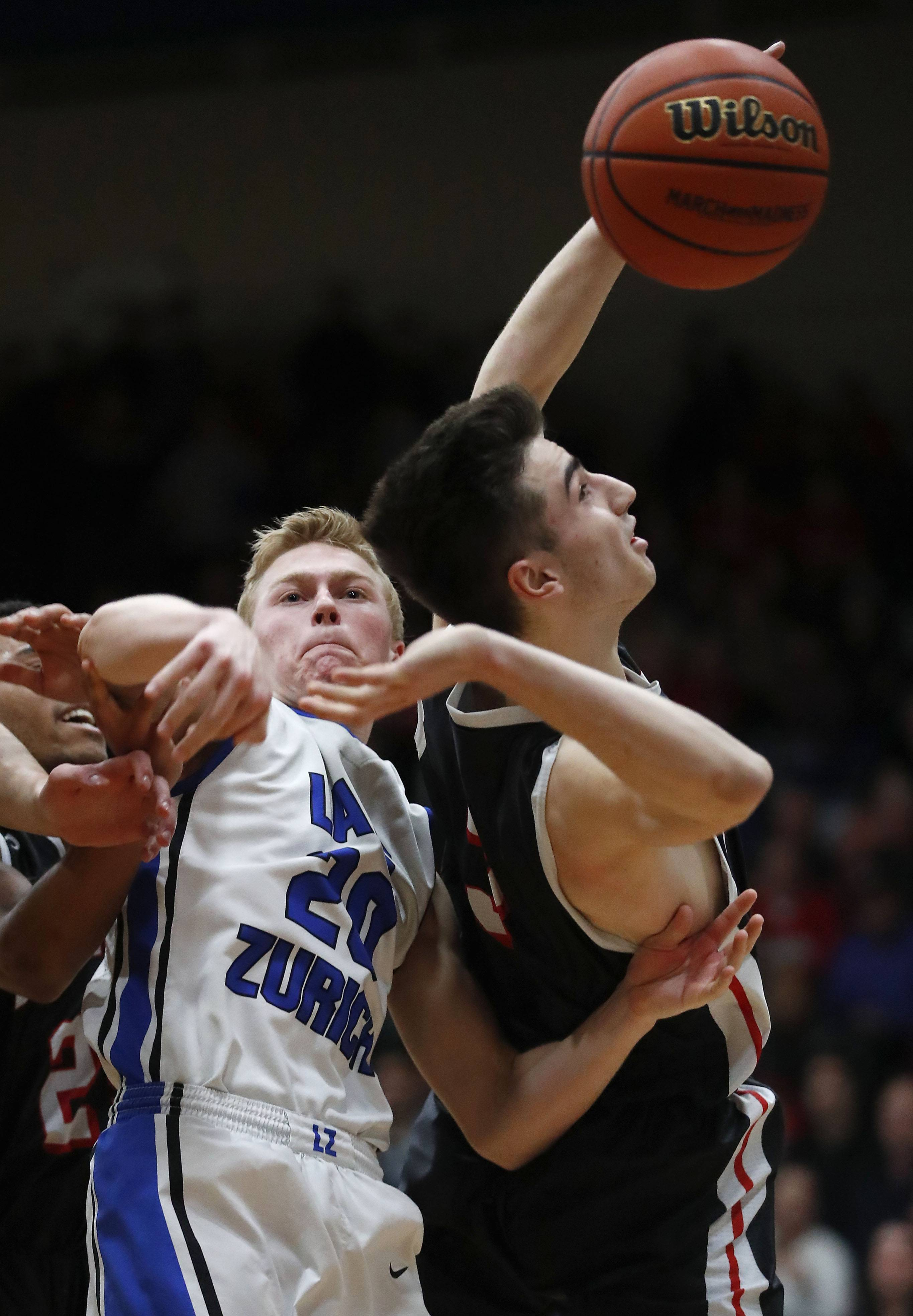 Lake Zurich's Joe Heffernan, left, and Barrington's Mark Johnson battle for a rebound during the Class 4A sectional final at Lake Zurich on Friday.