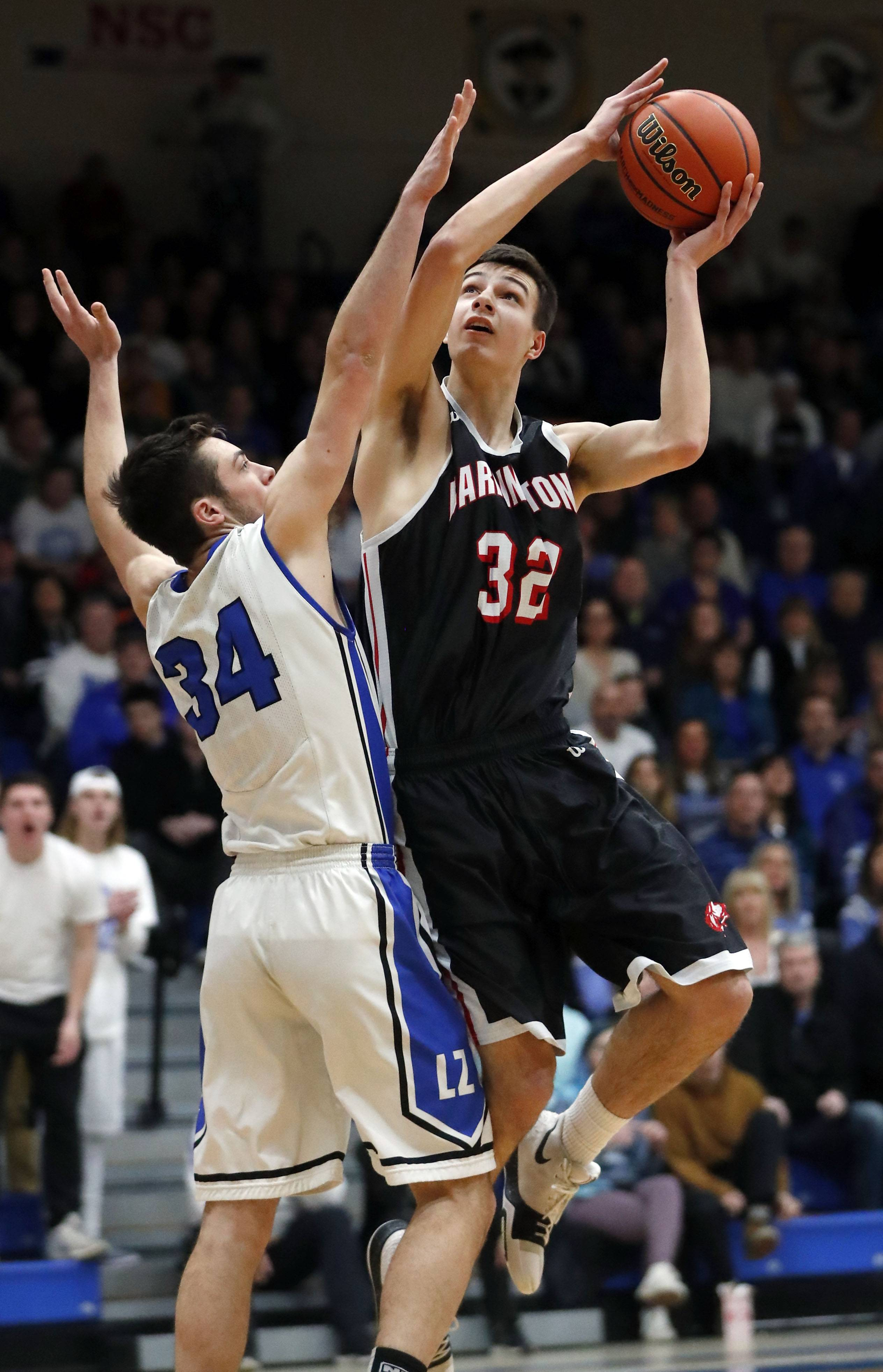 Barrington's Jack Reinhard (32) shoots over Lake Zurich's Ryan Kutsor during the Class 4A sectional final at Lake Zurich on Friday.
