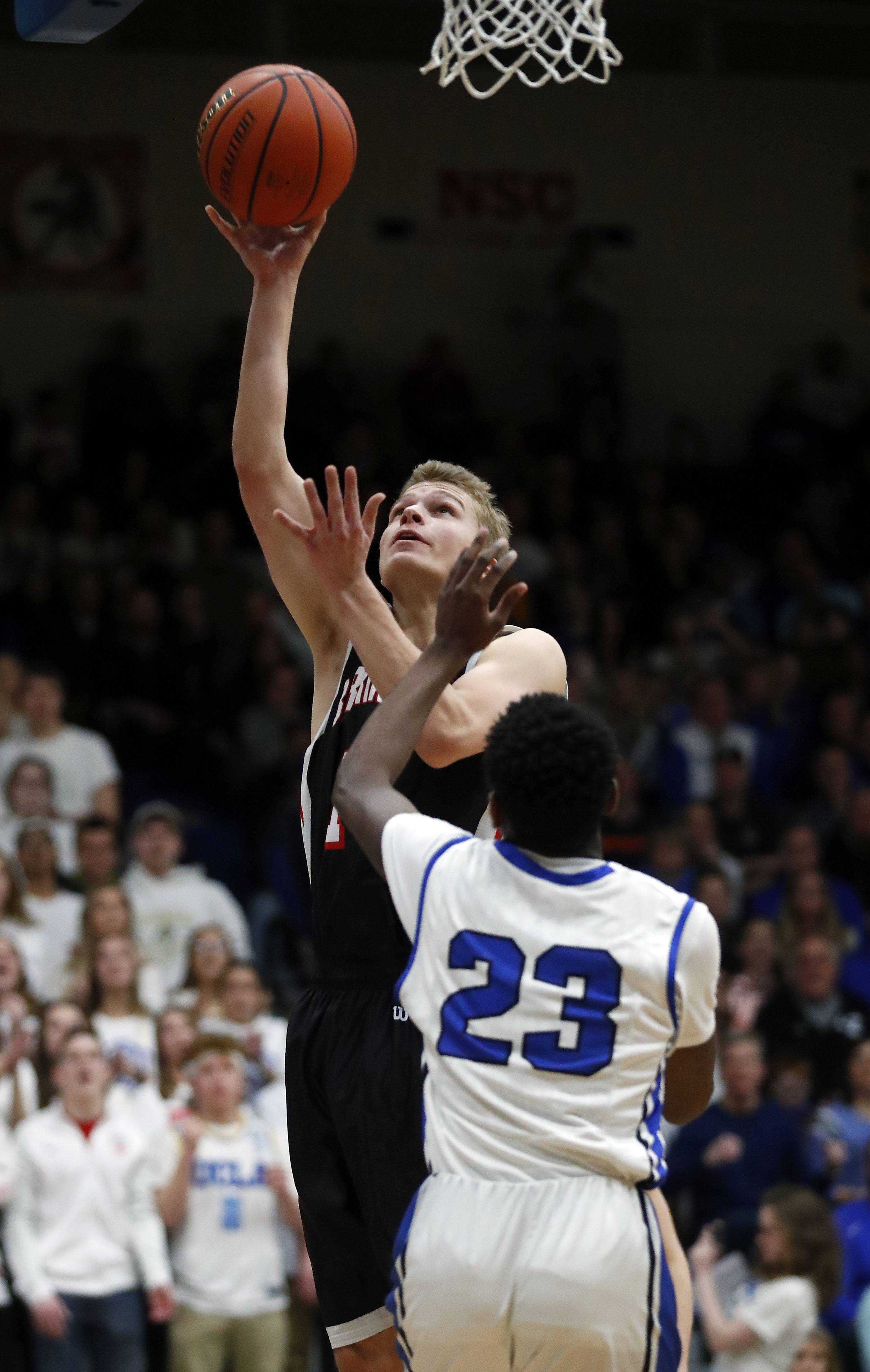 Barrington's Justin Alperin shoots over Lake Zurich's Kenny Haynes during the Class 4A sectional final at Lake Zurich on Friday.