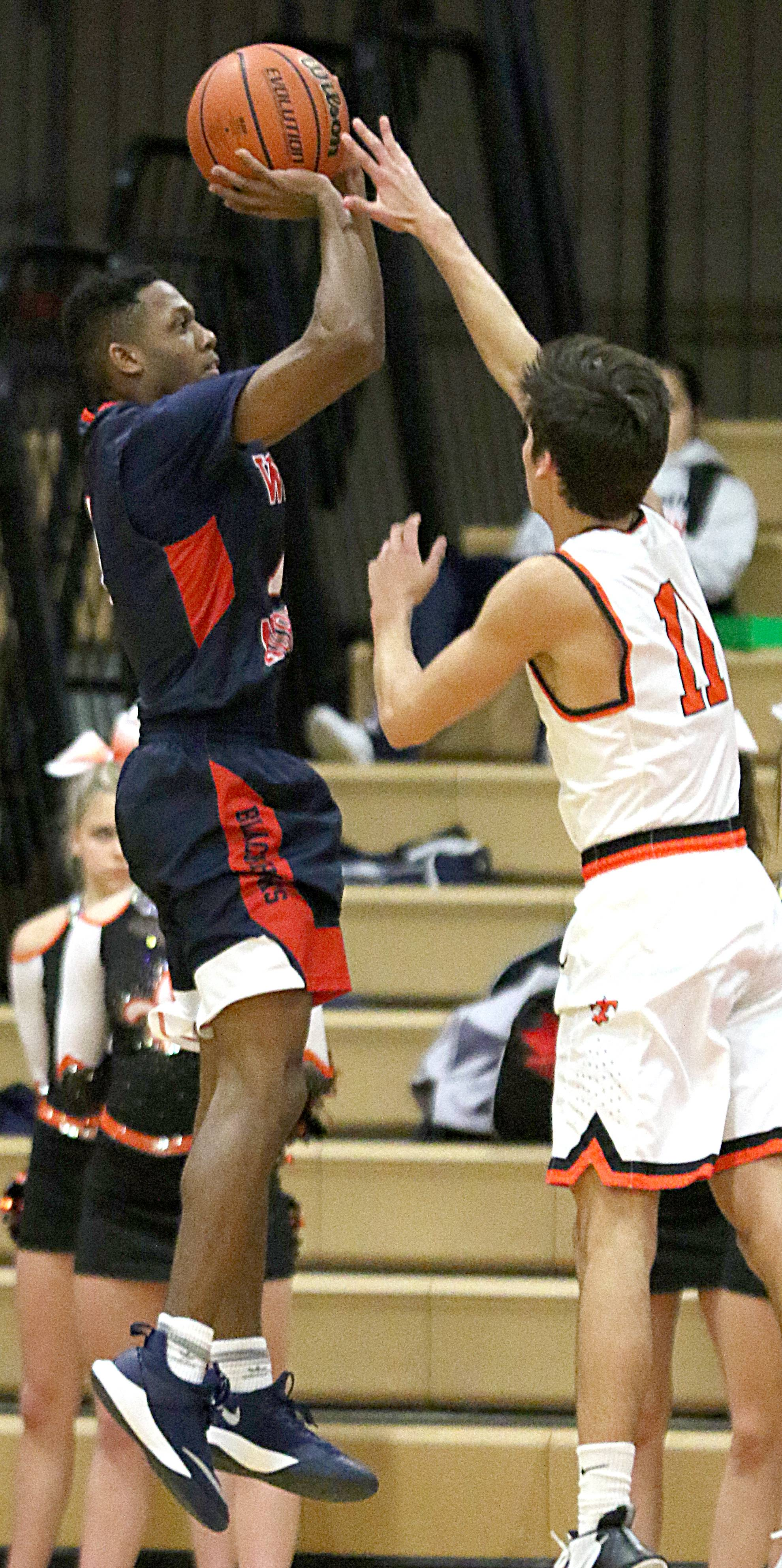West Aurora's Traevon Brown takes a jumper against St. Charles earlier this season. The Blackhawks battle Belleville West Tuesday in the Illinois State supersectional at Redbird Arena in Normal.