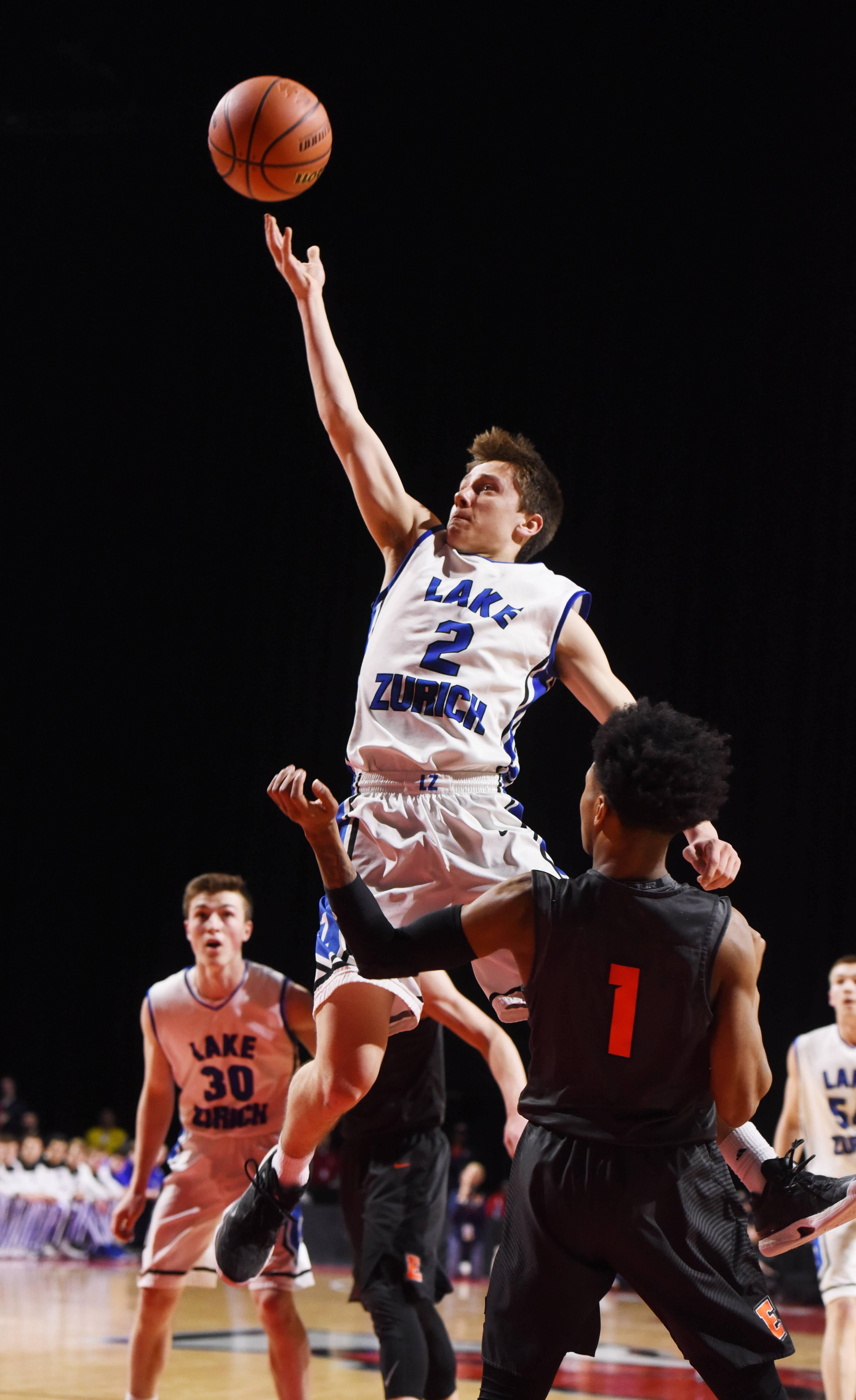 Lake Zurich's JR Cison drives to the basket for a layup against Evanston's Jaheim Holden during Class 4A supersectional play at the Sears Centre in Hoffman Estates on Tuesday.