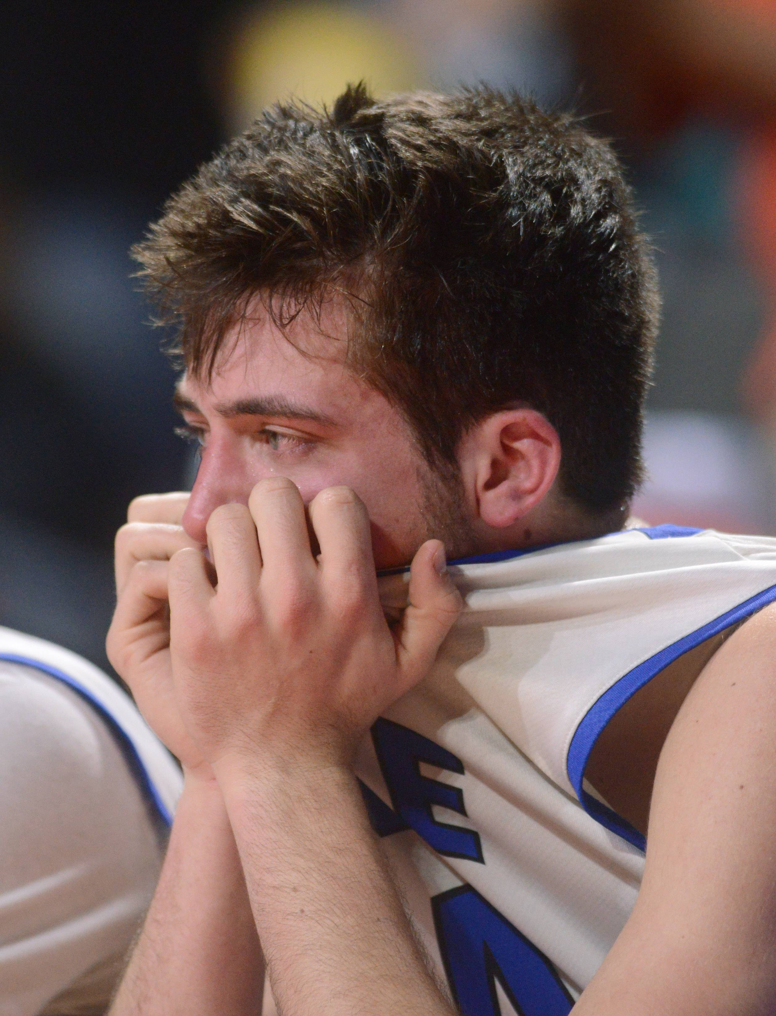 Lake Zurich's Ryan Kutsor reacts to the Bears' loss to Evanston in the Class 4A supersectional at the Sears Centre.