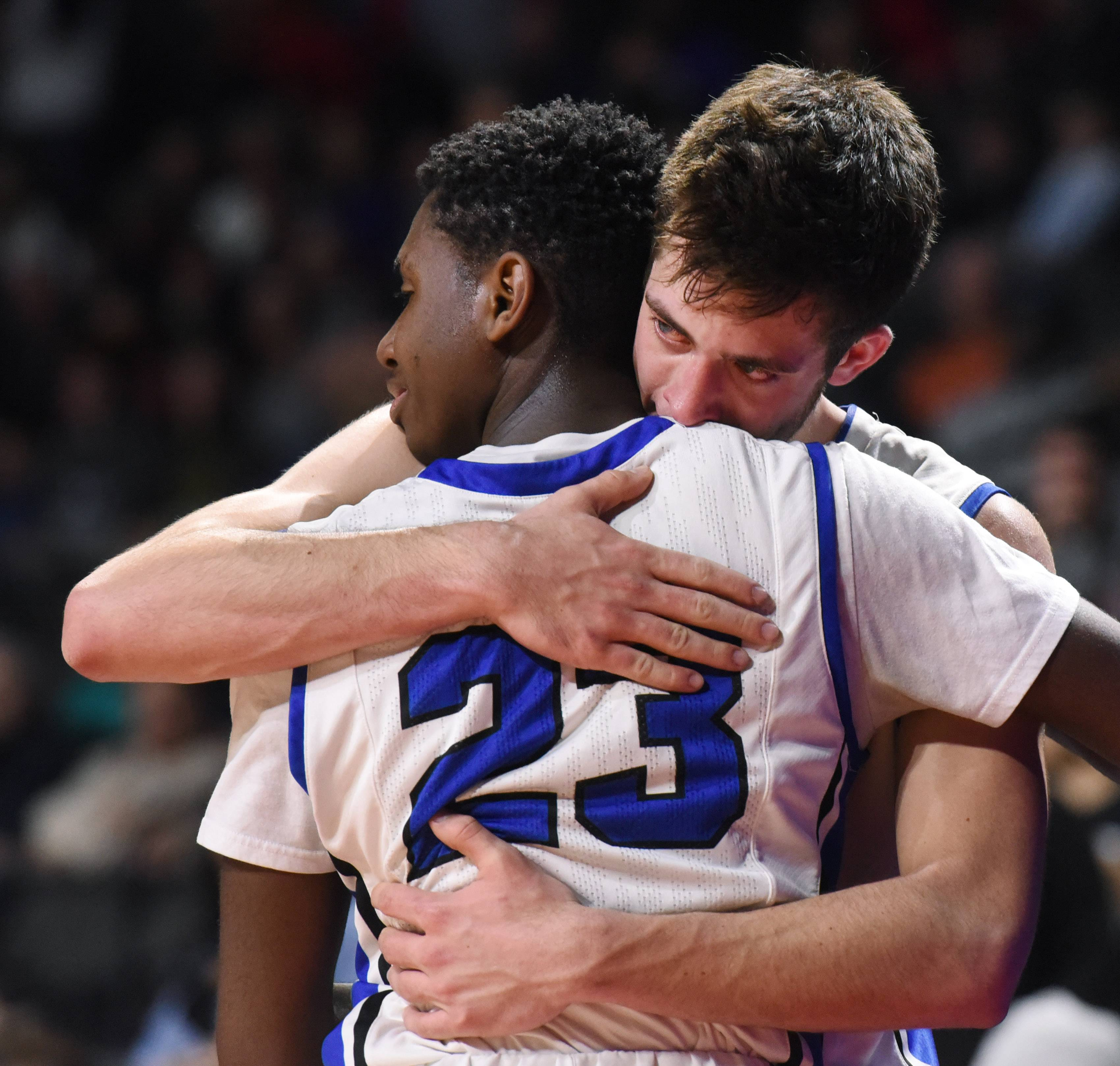 Lake Zurich's Kenny Haynes, front, embraces teammate Ryan Kutsor after both players came out of the game for substitutes in the closing minutes of the Bears' loss to Evanston in the Class 4A supersectional at the Sears Centre in Hoffman Estates on Tuesday.