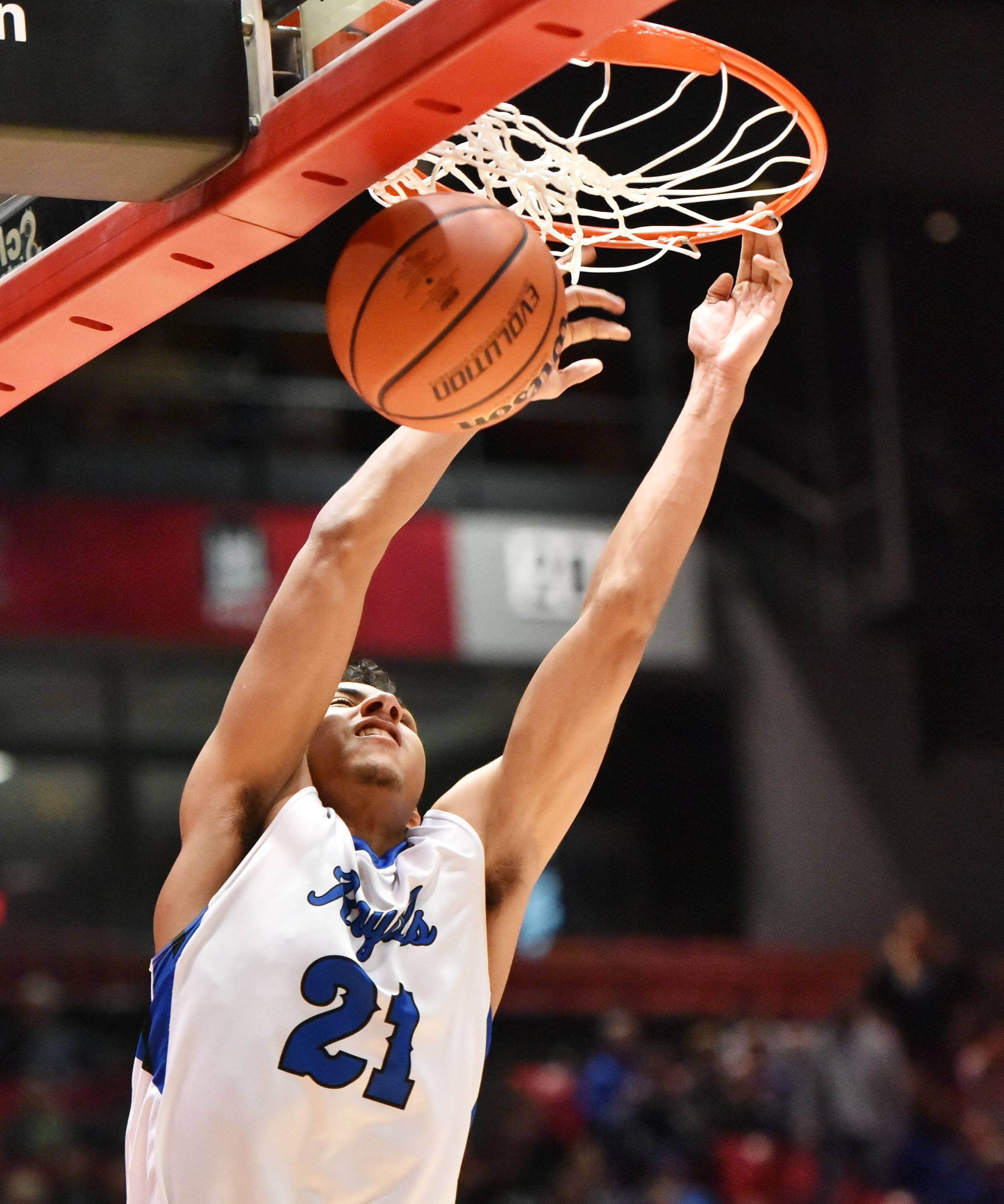 Larkin's Anthony Lynch dunks against Benet in the Class 4A supersectional boys basketball game at Northern Illinois University Tuesday.