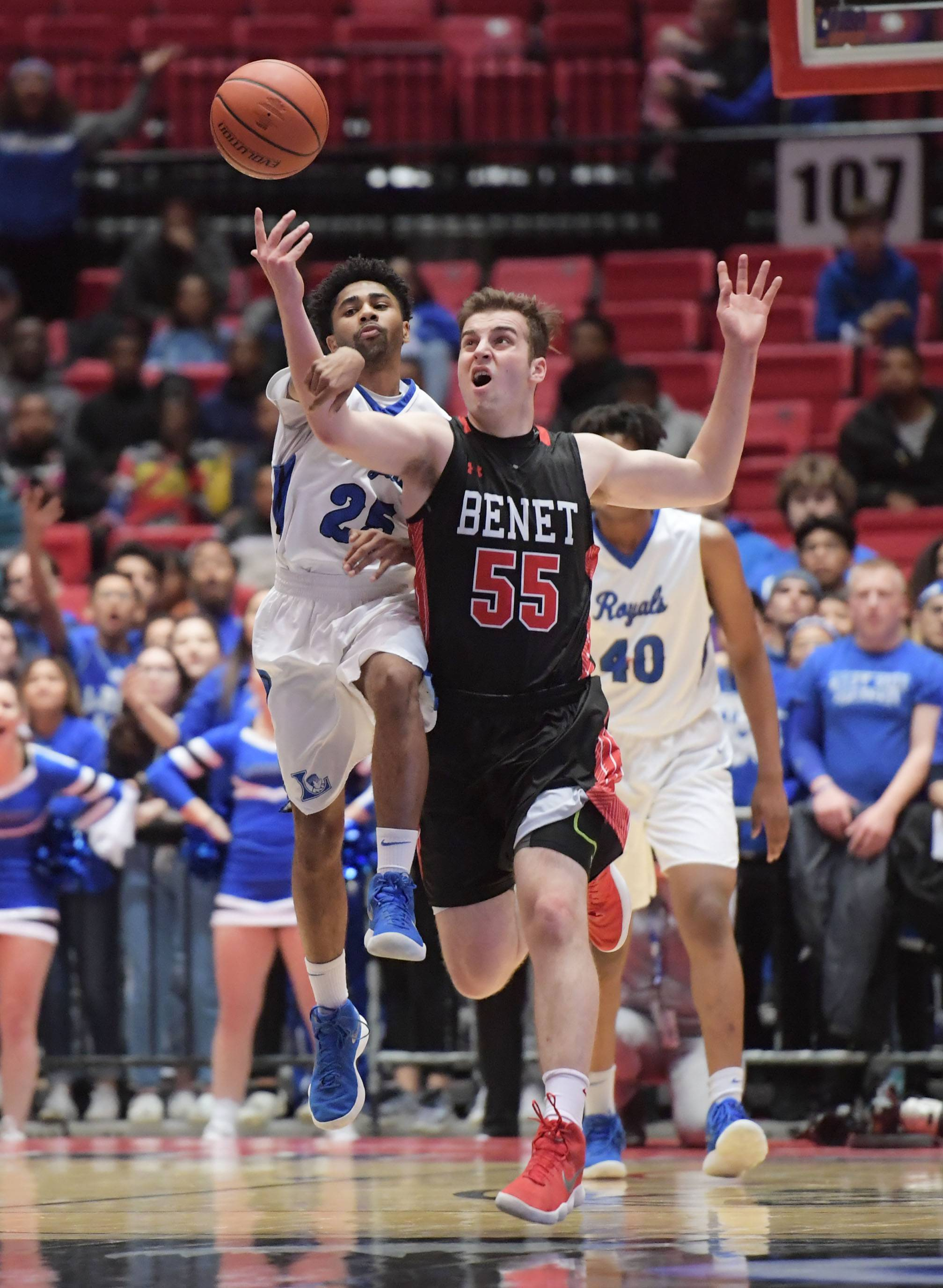 Larkin's Christopher Rose and Benet's Colin Crothers battle for the ball in the Class 4A supersectional boys basketball game at Northern Illinois University Tuesday.and we