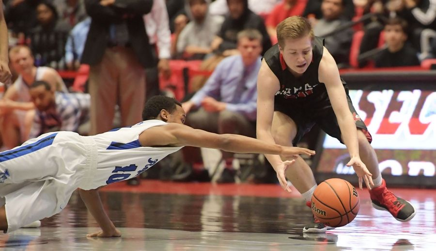 Larkin's Kindrel Morris dives for a loose ball as Benet's Jake Ronneberg gets there first during Class 4A supersectional action at Northern Illinois University on Tuesday.