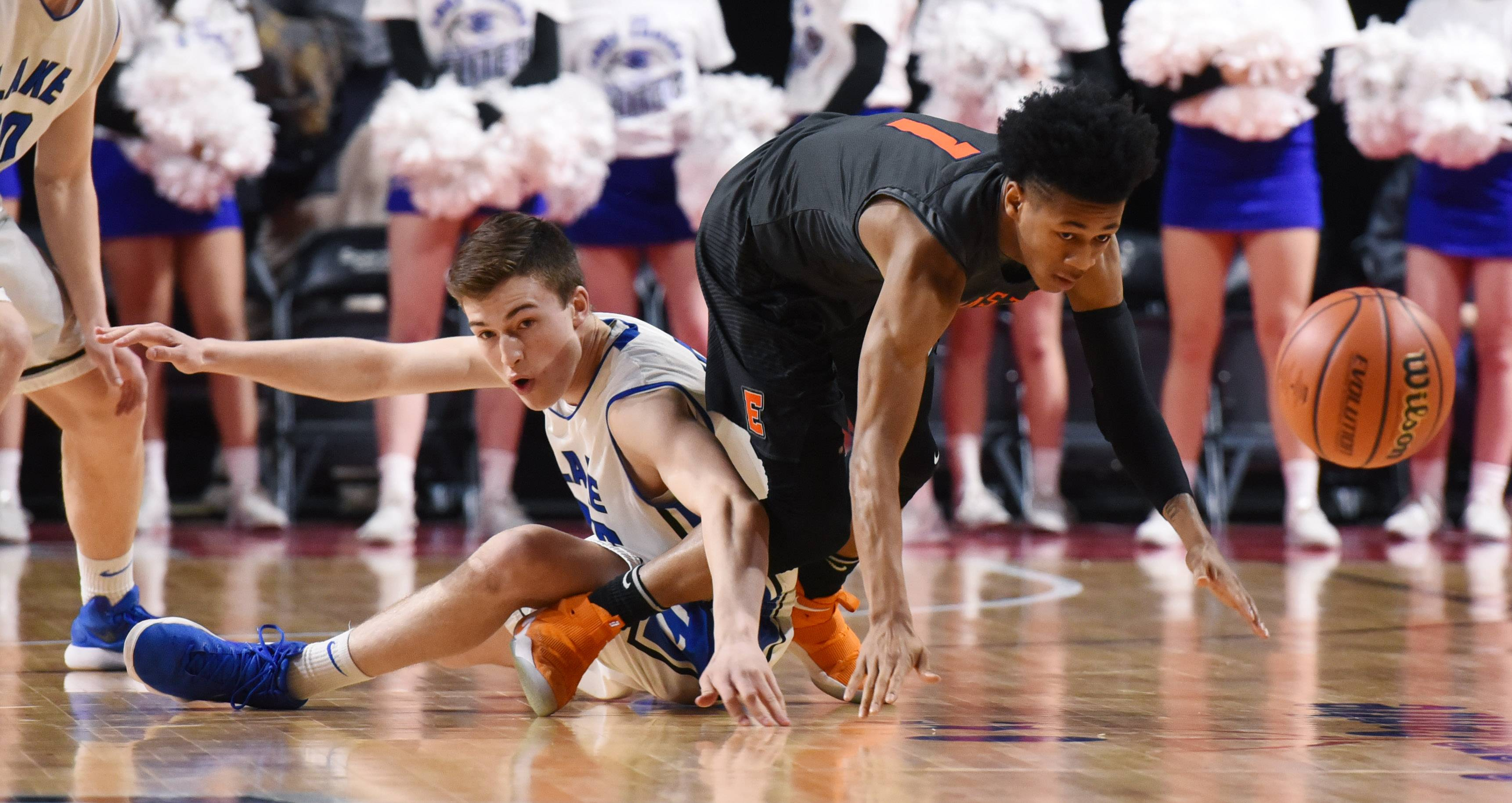 Lake Zurich's Will Tucker, left, tries to get jar the ball loose against Evanston's Jaheim Hiolden during the Class 4A supersectional at the Sears Centre in Hoffman Estates on Tuesday.