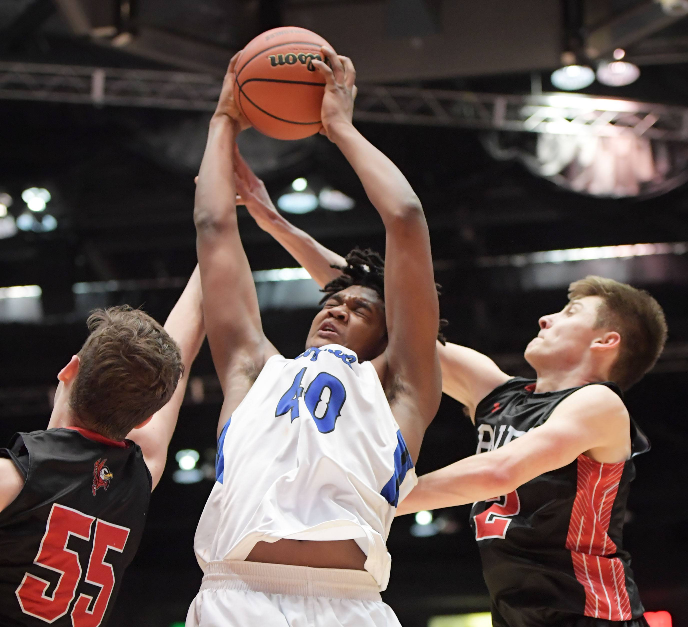 Larkin's Jalen Shaw gets rebound while drawing Benet defenders Colin Crothers and David Buh in Class 4A supersectional play at Northern Illinois University on Tuesday.
