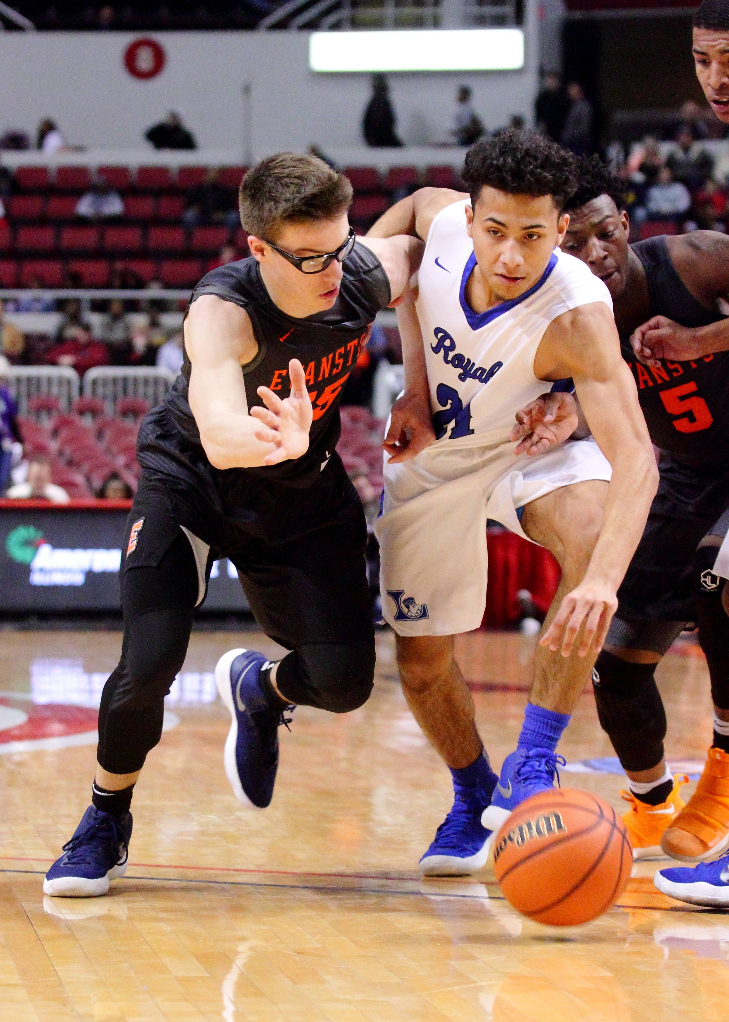 Larkin's Anthony Lynch drives toward the paint between Evanston's Blake Peters and Lance Jones on Saturday during the Class 4A third-place game in Peoria.