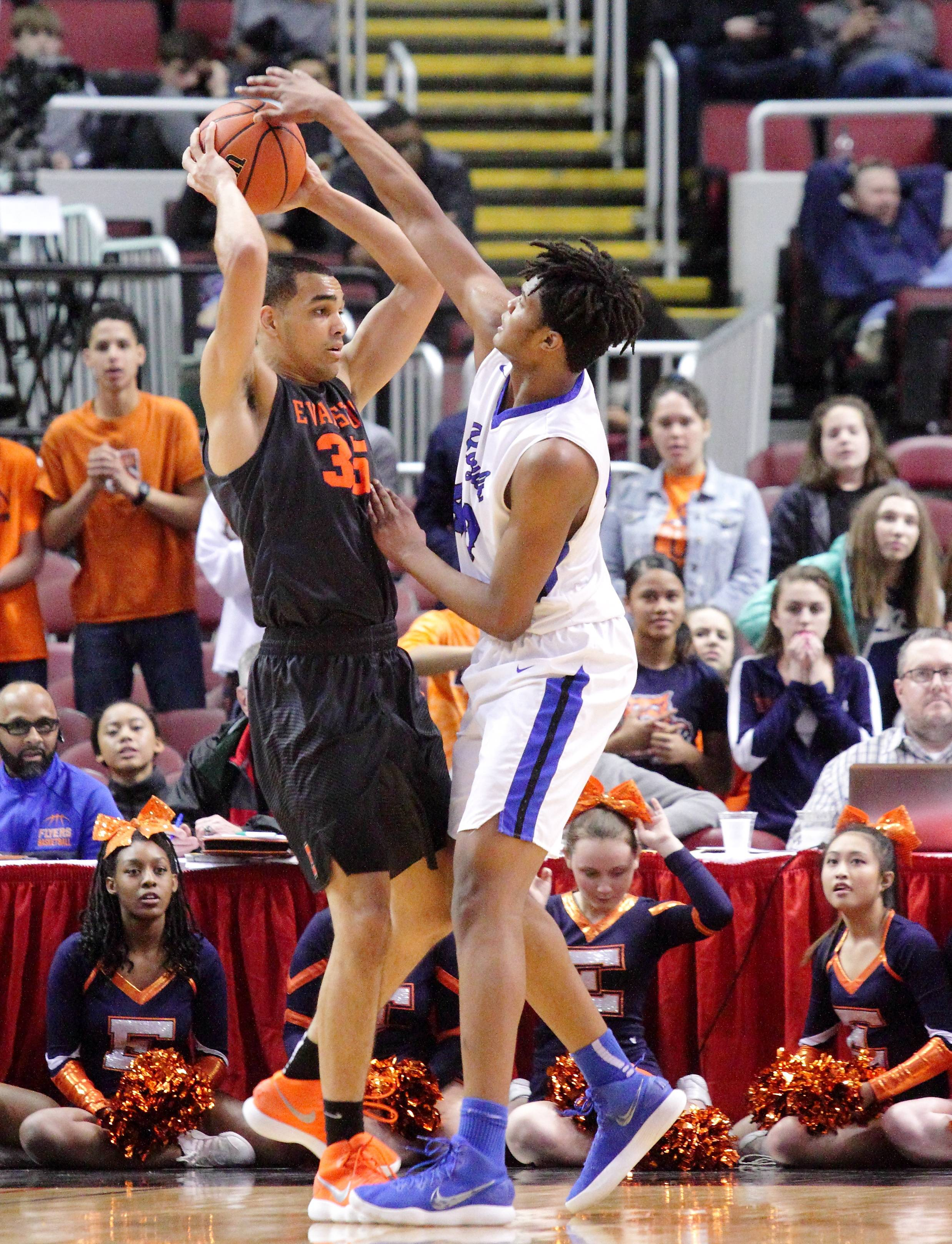 Larkin's Jalen Shaw plays tight defense on Evanston's Matt Hall on Saturday during the Class 4A third-place game in Peoria.