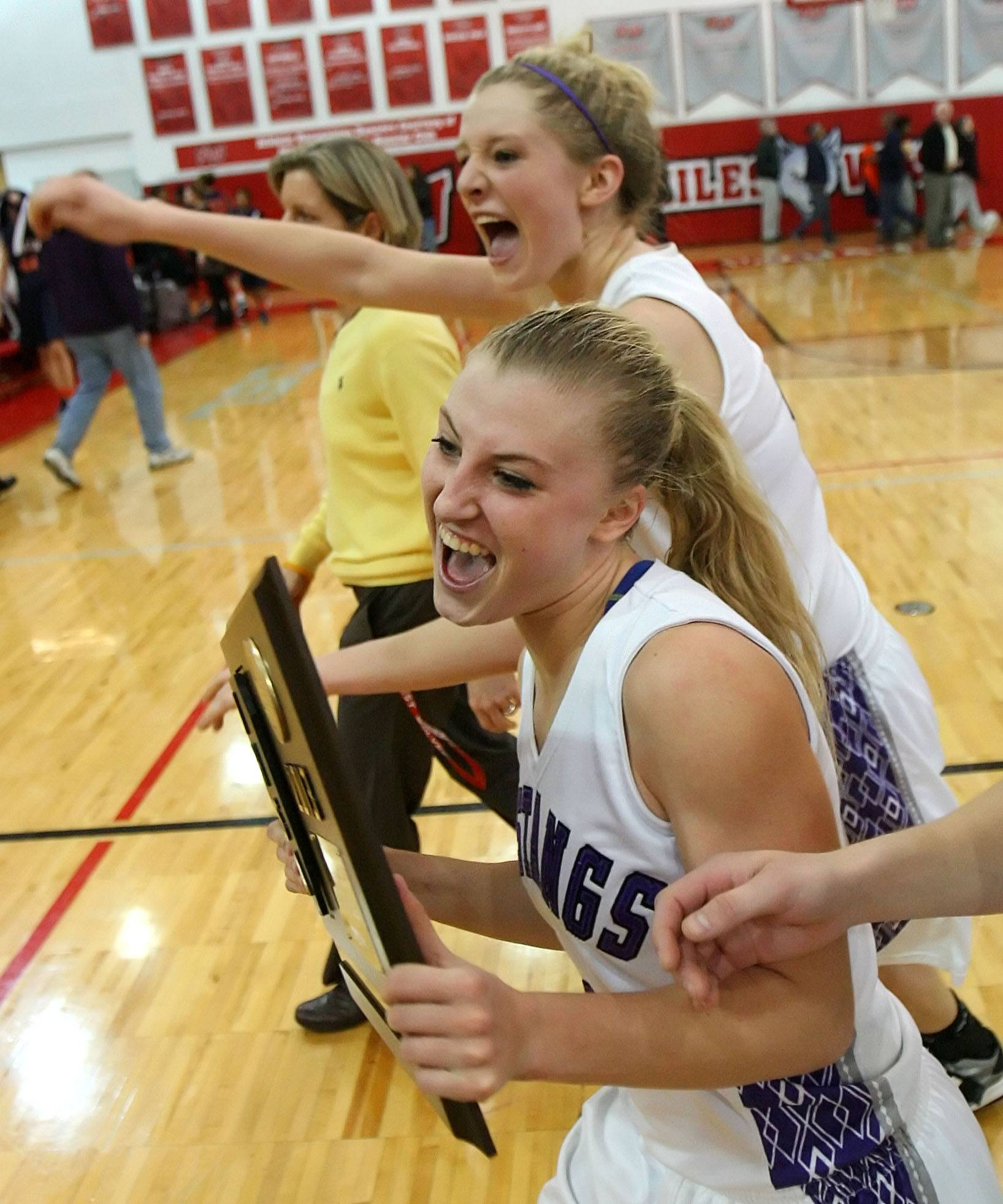 Jenny Vliet, back, and Jackie Kemph celebrate a supersectional title during their high school playing days at Rolling Meadows. Both finished among the career leaders at St. Louis after recently wrapping up their collegiate basketball careers.