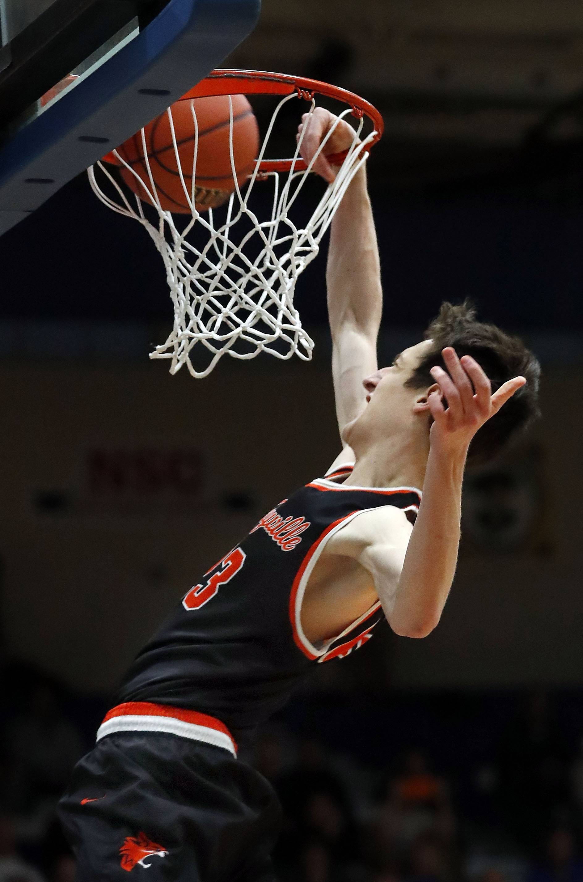 Libertyville's Drew Peterson goes in for a dunk during recent sectional semifinal action at Lake Zurich.