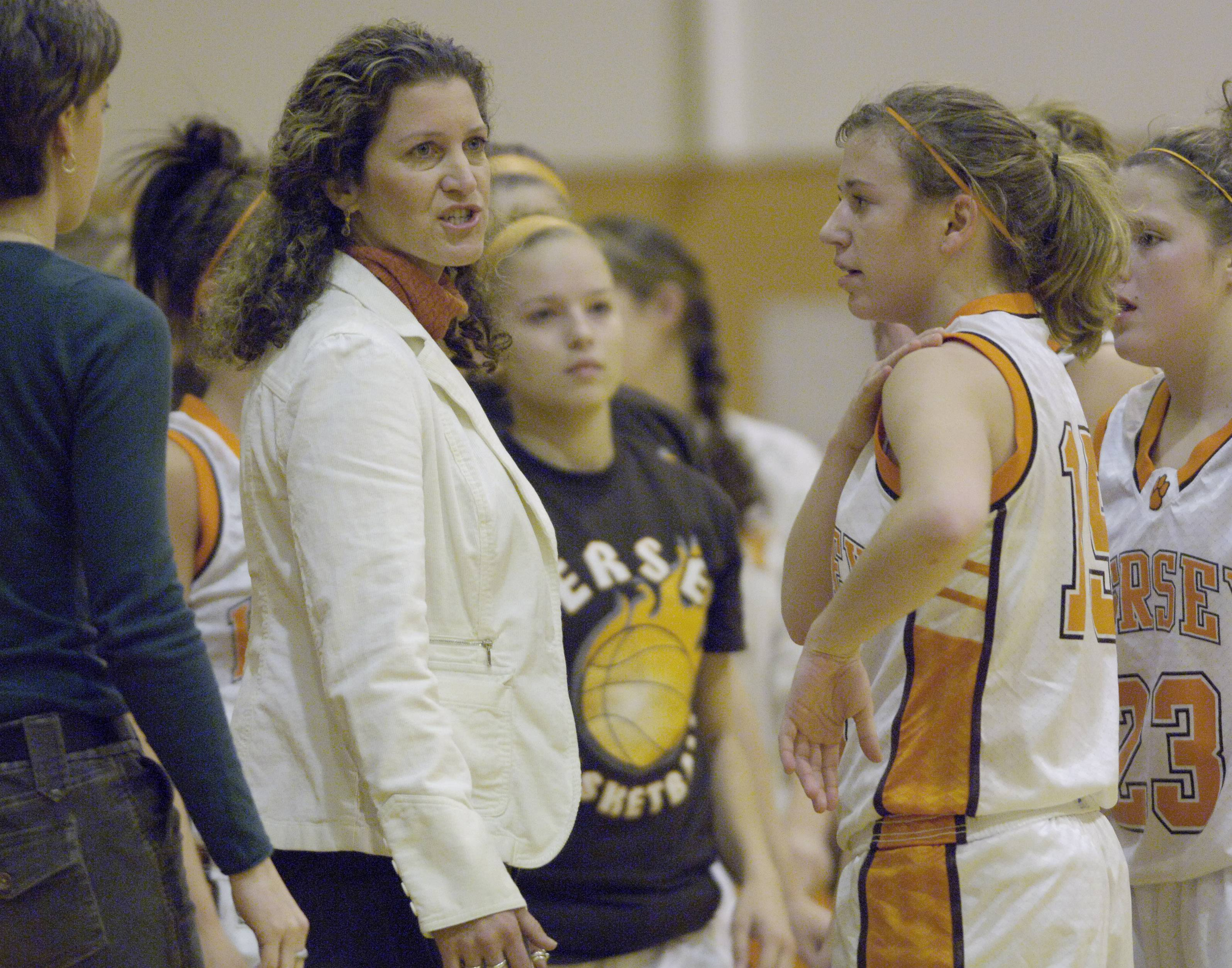 Joe Lewnard/jlewnard@dailyherald.comHersey girls basketball coach Mary Fendley, here with her team during a timeout in the 2006 season, recently joined the IBCA Hall of Fame.