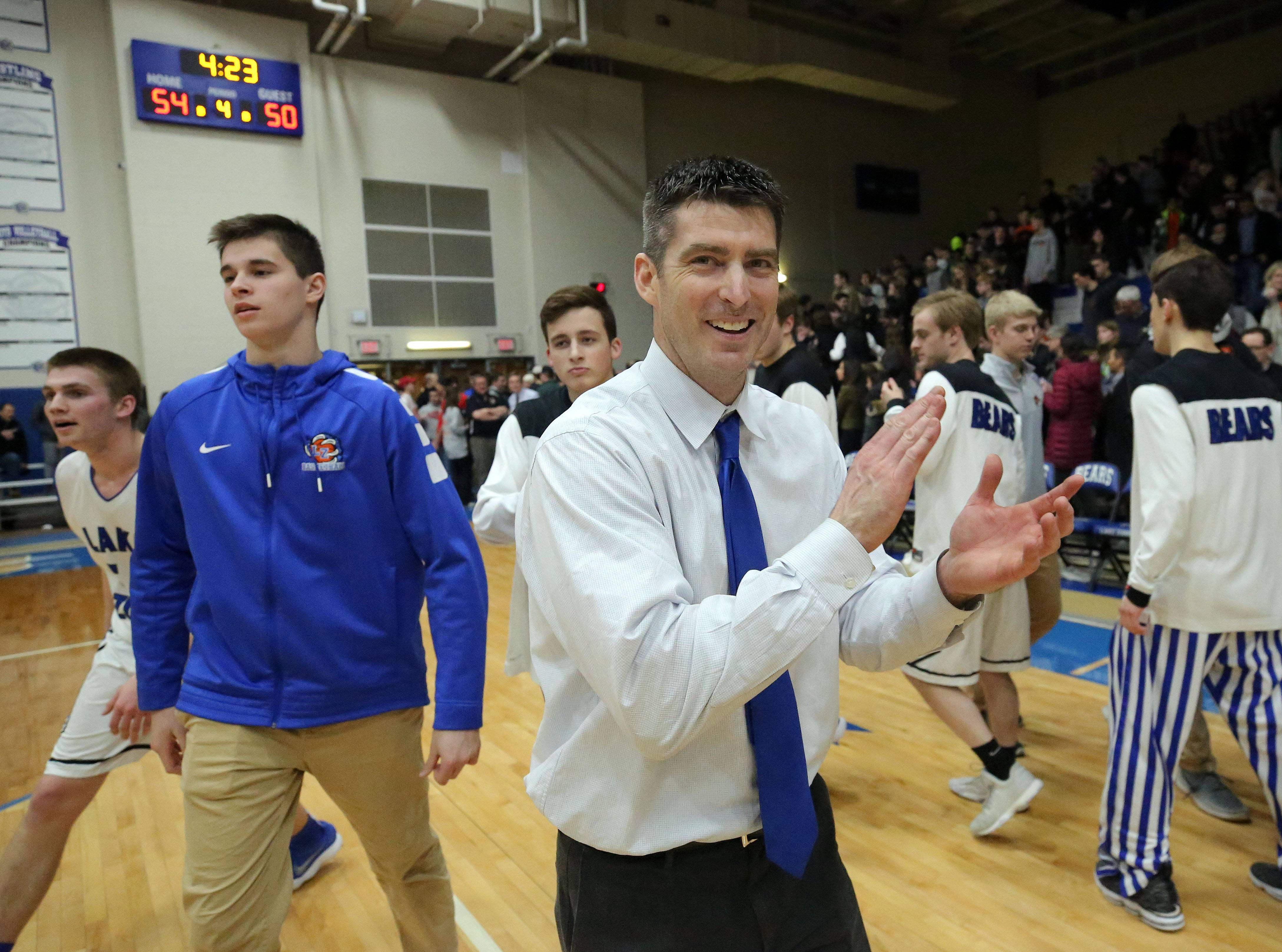Lake Zurich coach Billy Pitcher celebrates after the Bears' 54-50 win over Libertyville in Class 4A sectional semifinal play at Lake Zurich.