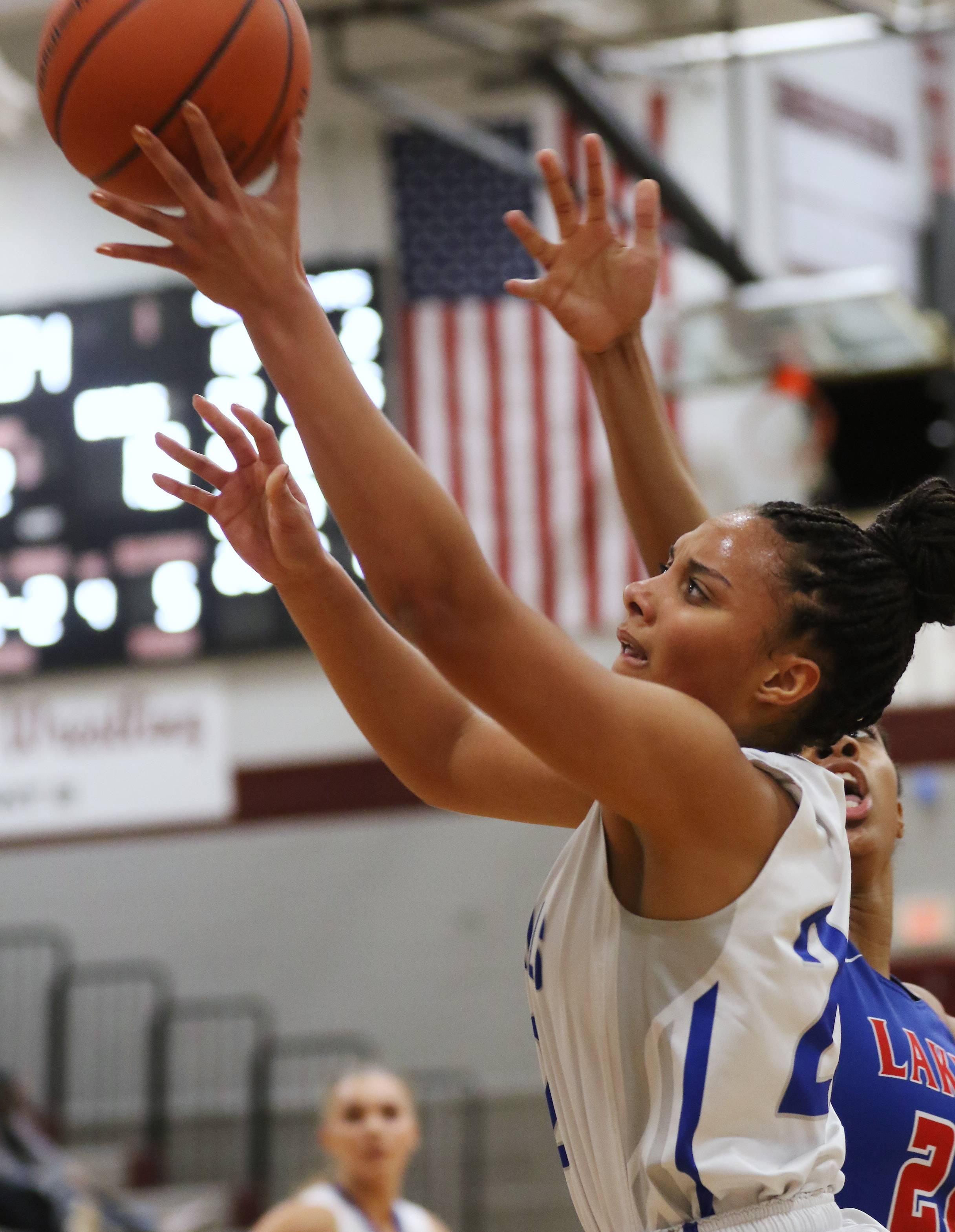 Vernon Hills center Kayla Caudle goes up for a layup during regional final action against Lakes at Antioch last season. Caudle has committed to a collegiate basketball future at DePaul.