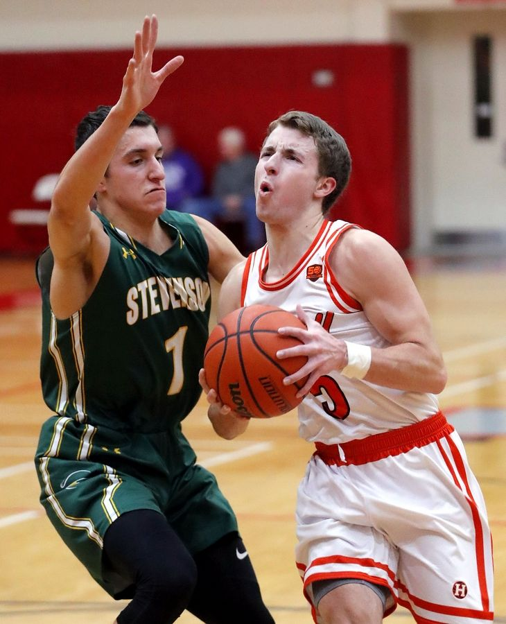Hersey's Davis Belford, right, drives on Stevenson's John Ittounas during their game Tuesday at Palatine High School.