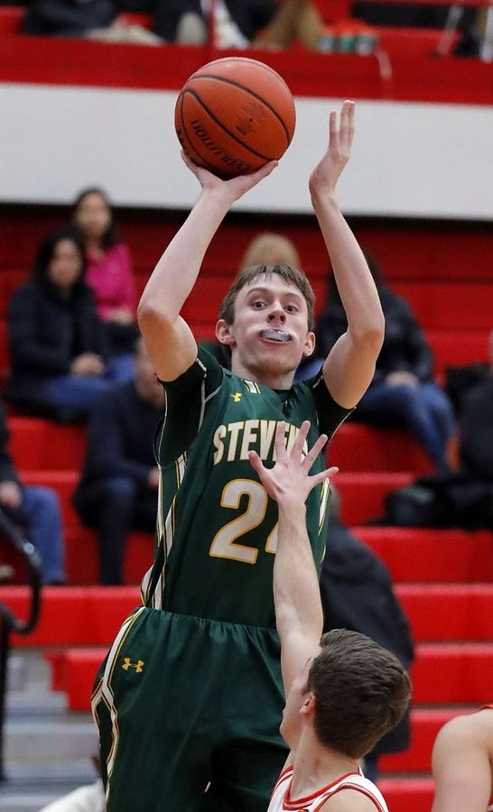 Stevenson's Matthew Ambrose shoots a jumper during their game against Hersey Tuesday at Palatine High School.