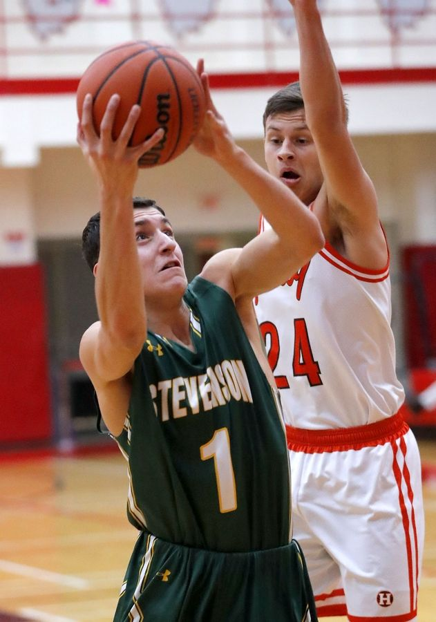 Stevenson's John Ittounas (1) drives on Hersey's Rocco Ronzio during their game Tuesday at Palatine High School.