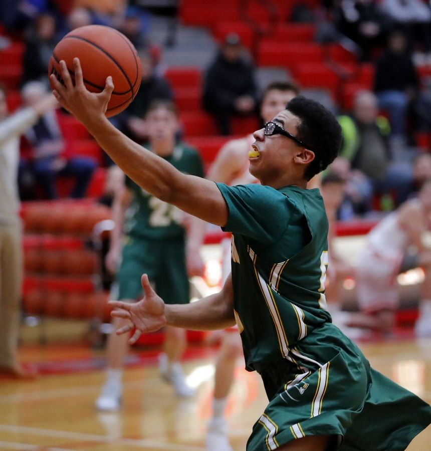 Stevenson's Trey Baker drives to the hoop during their game Tuesday at Palatine High School.