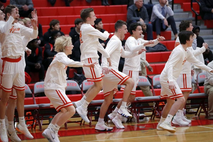 Hersey's bench reacts after a 3-pointer at the end of the first quarter during their game against Stevenson Tuesday at Palatine High School.