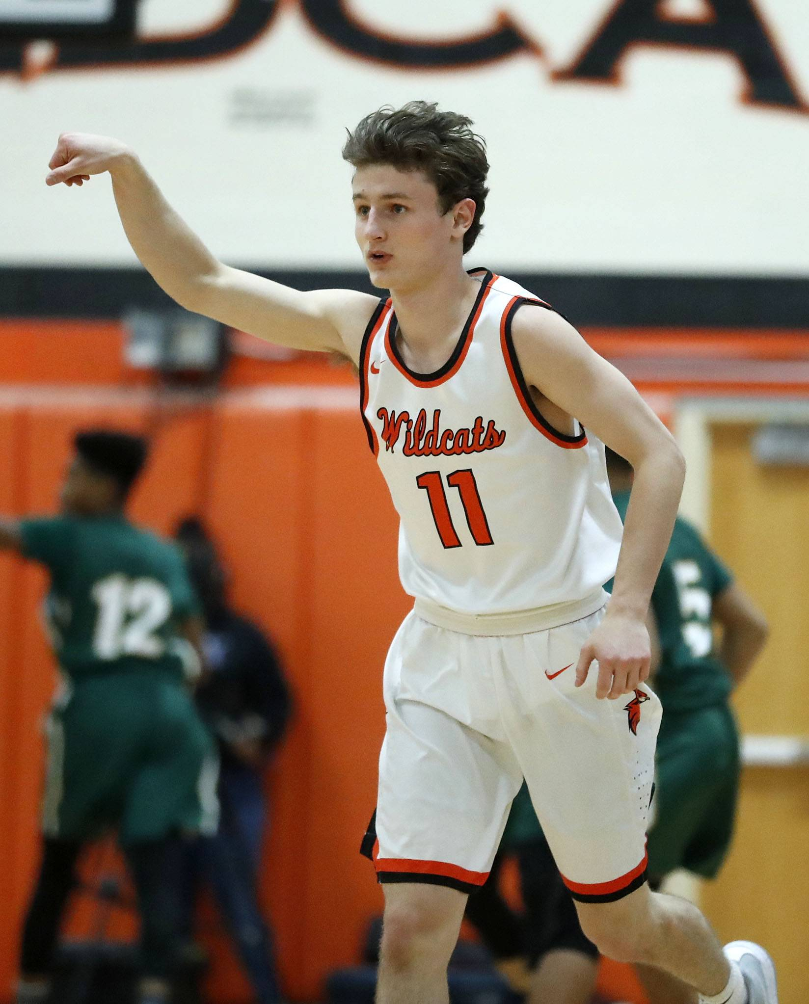 Libertyville's Josh Steinhaus gestures after hitting a 3-pointer during their game against Stevenson Tuesday night in Libertyville.