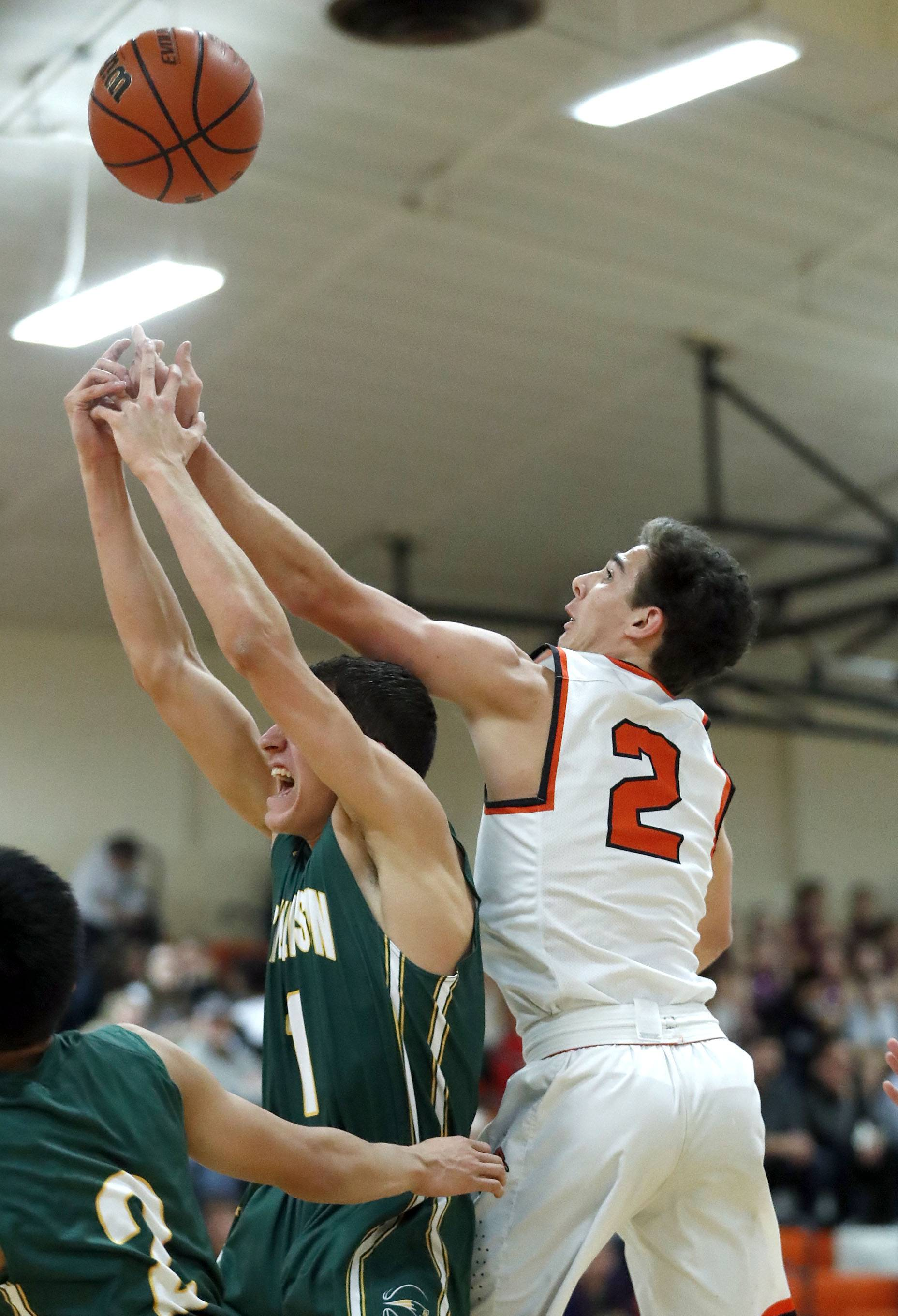 Libertyville's Brian Wilterdink (2) and Stevenson's John Ittounas battle for a rebound during their game Tuesday night in Libertyville.