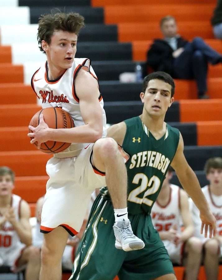 Libertyville's Josh Steinhaus, left, pulls down a rebound over Stevenson's Ethan Kolesky during their game Tuesday night in Libertyville.